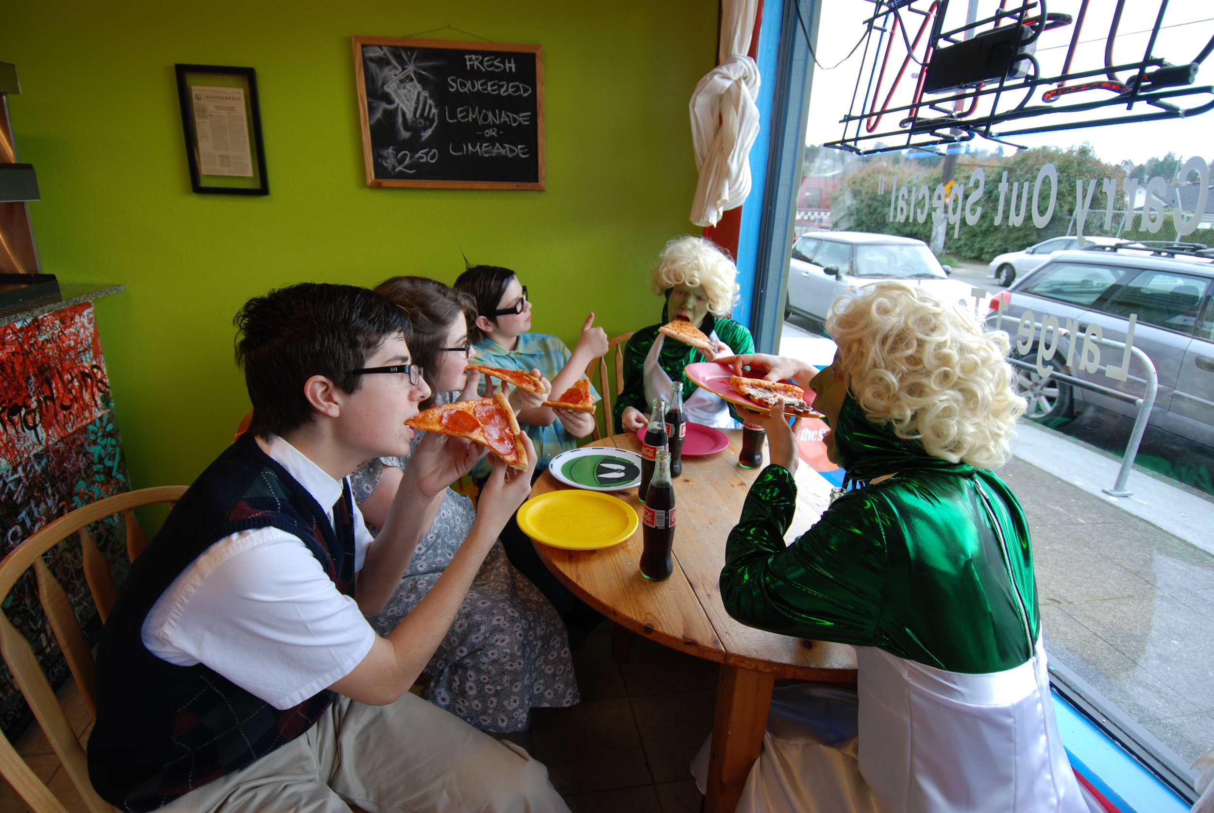 Meanwhile, local science students, Billy Jones,Eugene Simmons and Carol O'Hara. introduce pizza to their new alien friends, Prozac and Zyrtec.