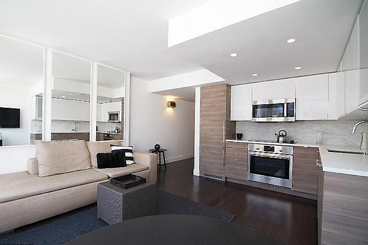 INTERIOR RENOVATION - RESIDENTIAL CONDOMINIUM SUITE  SCOPE OF WORK: PRELIMINARY DESIGN, DESIGN DEVELOPMENT, CONSTRUCTION DOCUMENTS, CONSTRUCTION ADMINISTRATION, FINISH, FIXTURE AND EQUIPMENT SELECTIONS AND CUSTOM MILLWORK