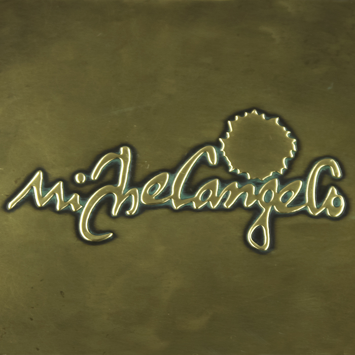 EMBOSSED BRASS PLATE WITH VERDI GRIS PATINA