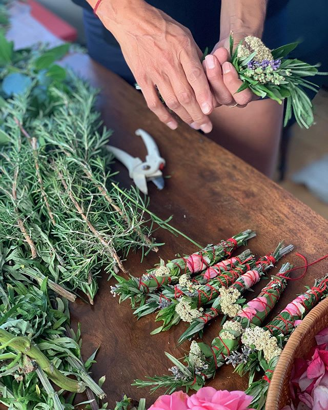Learning how to make smudge bundles to fundraise for the Toki Amanwani project. I love how Shayne wrote about our upcoming service trip. 🌸  From Shayne Case:  Handmade Smudge Bundles woven with stories, roses, laughter, mugwort, dreams, cedar, magic, lavender, love, bay, hopes, yarrow, spirit, rosemary, and a dedication towards service. ❤️ Last night, @tendthenest, @choybot, @southersalazar, and @touk_keo sat around a long wood table making these babies. We imagined a better world where laughter was THE medicine and compassion was the way. We learned to tie bundles like my relations on the rez first showed me. We talked about sacred work. ❤️ At the end of September, the five of us will travel to my reservation, the Cheyenne River Sioux Reservation, to make flower essences from native plants on tribal lands. This medicine will directly benefit the youth on the rez who suffer a 19-21 % higher suicide rate than any other group on this continent. Transgenerational trauma, oppression, and cultural genocide is still a plague in our community AND the heart is strong. The native spirit is resilient, intelligent, and a warrior of love. We need YOUR support! ❤️❤️❤️❤️❤️❤️❤️❤️❤️❤️ PLEASE purchase these beautiful smudge bundles from @tendthenest for $25 - $10,000 😊😊😊😊 All proceeds will go to funding our trip to the rez to serve the youth through the Cheyenne River Youth Project and the making of sacred medicine. ❤️❤️❤️ You may also donate directly to the Toki Amanwani Project on my website: www.shaynecase.com.  Philámayaye! Thank you ❤️❤️ #tokiamanwaniproject #smudge #cheyenneriveryouthproject #undertheeagleswingmentorship