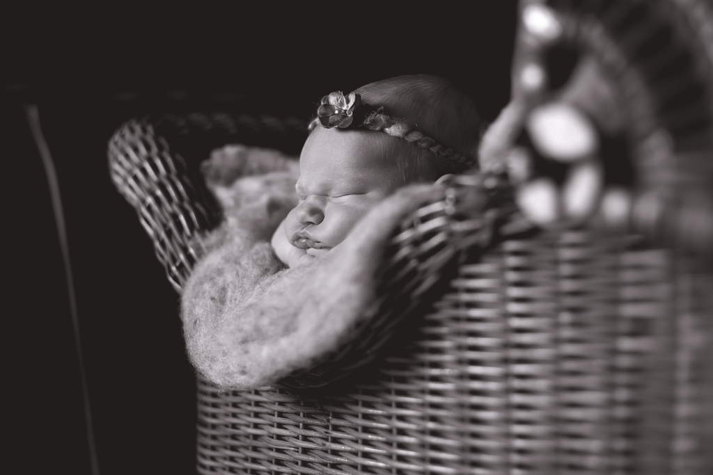 BW Newborn Image in 100 year old buggy by Newborn Photographer in San Diego CA