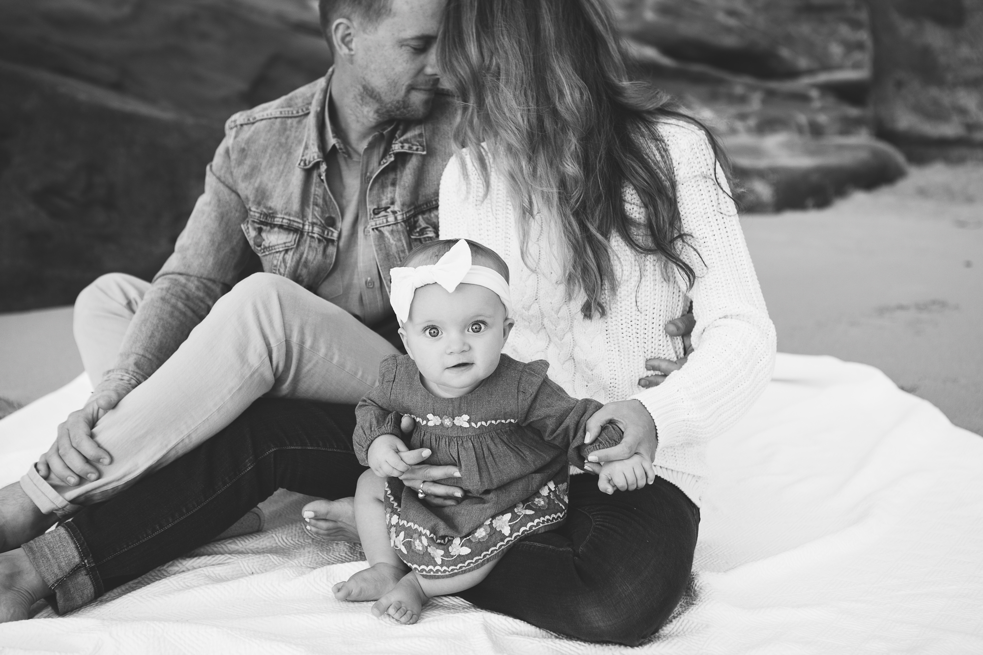 Family Pictures of returning Newborn Client capturing 9 month milestone pictures in San Diego CA