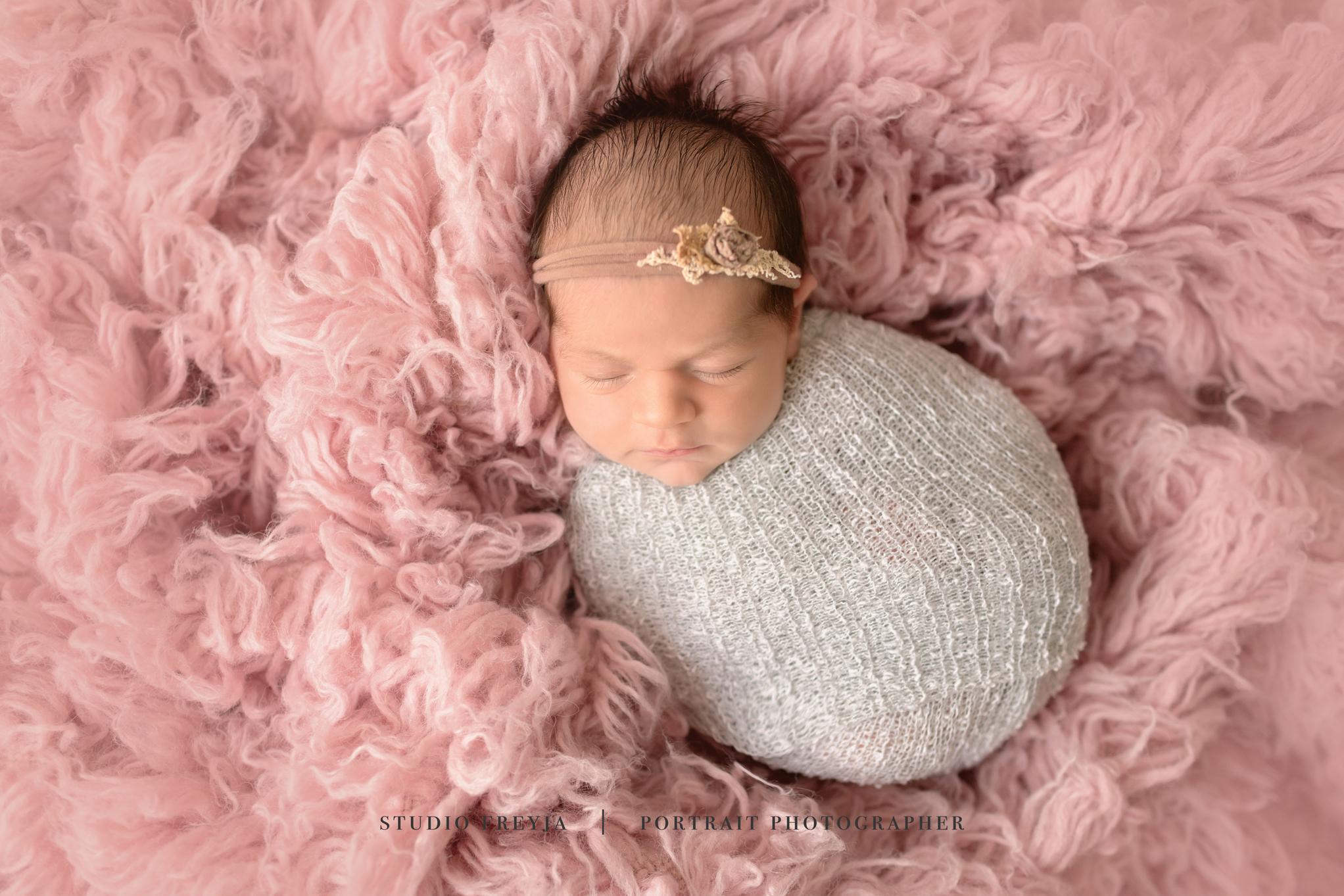 Newborn Girl on Pink Flokati San Diego Newborn Photographer