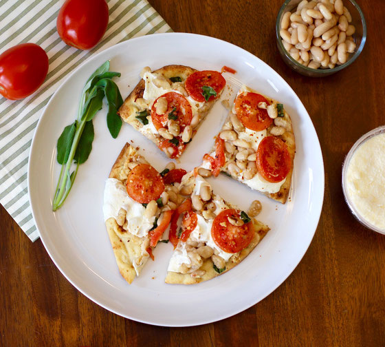 looking-for-healthy-recipes-this-tomato-and-white-bean-naan-pizza-is-vegetarian-and-can-be-eaten-for-breakfast-lunch-or-dinner-just-pop-it-in-the-oven.jpg
