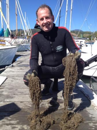 Dr Barrie Forrest with hull fouling seaweeds