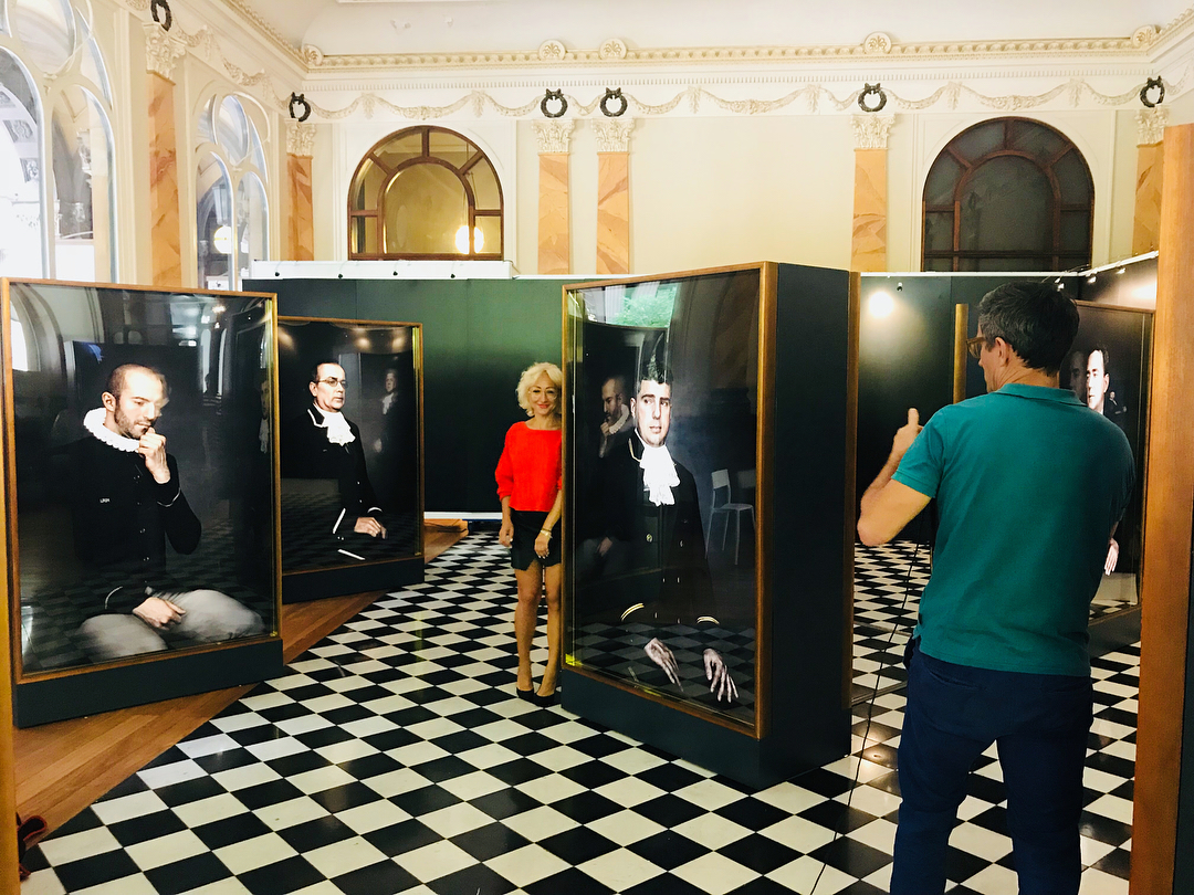 29 NOVEMBER 2018: BEHIND THE SCENES SNAP FROM THE SHOOT FOR THE AFR NEWSPAPER.  ARTIST ALINA GOZIN'A NEXT TO HER DOORMEN OF NEW YORK ART WORK BEFORE THE OPENING NIGHT AT WENTWORTH GALLERIES, GPO BUILDING, MARTIN PLACE , SYDNEY, AUSTRALIA