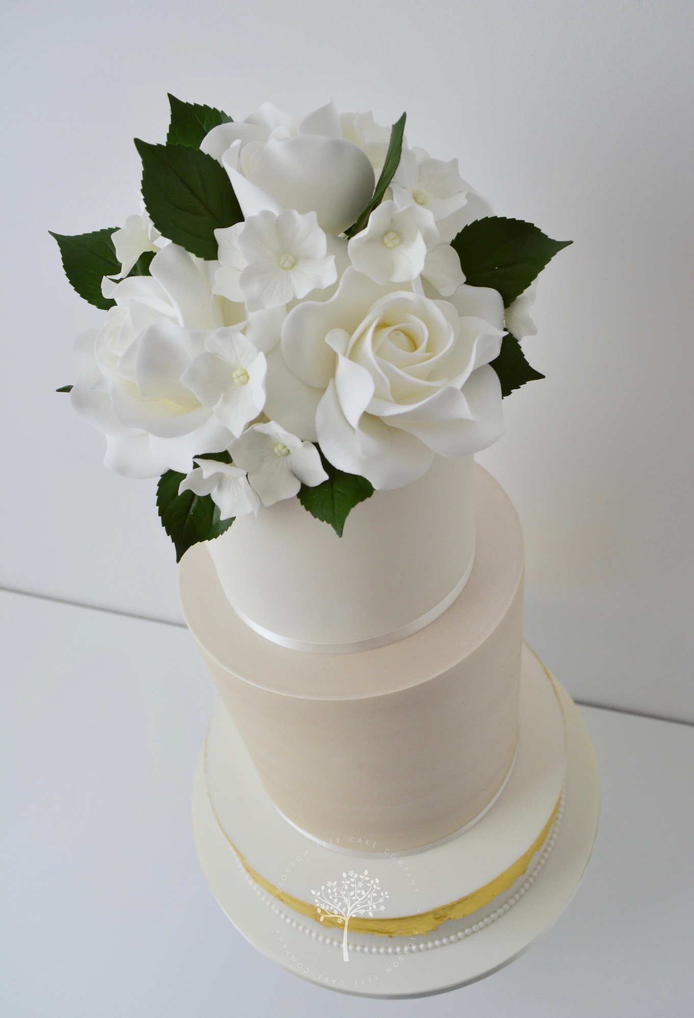 Champagne and White Roses wedding cake by Blossom Tree Cake Company Harrogate North Yorkshire - angle.jpg