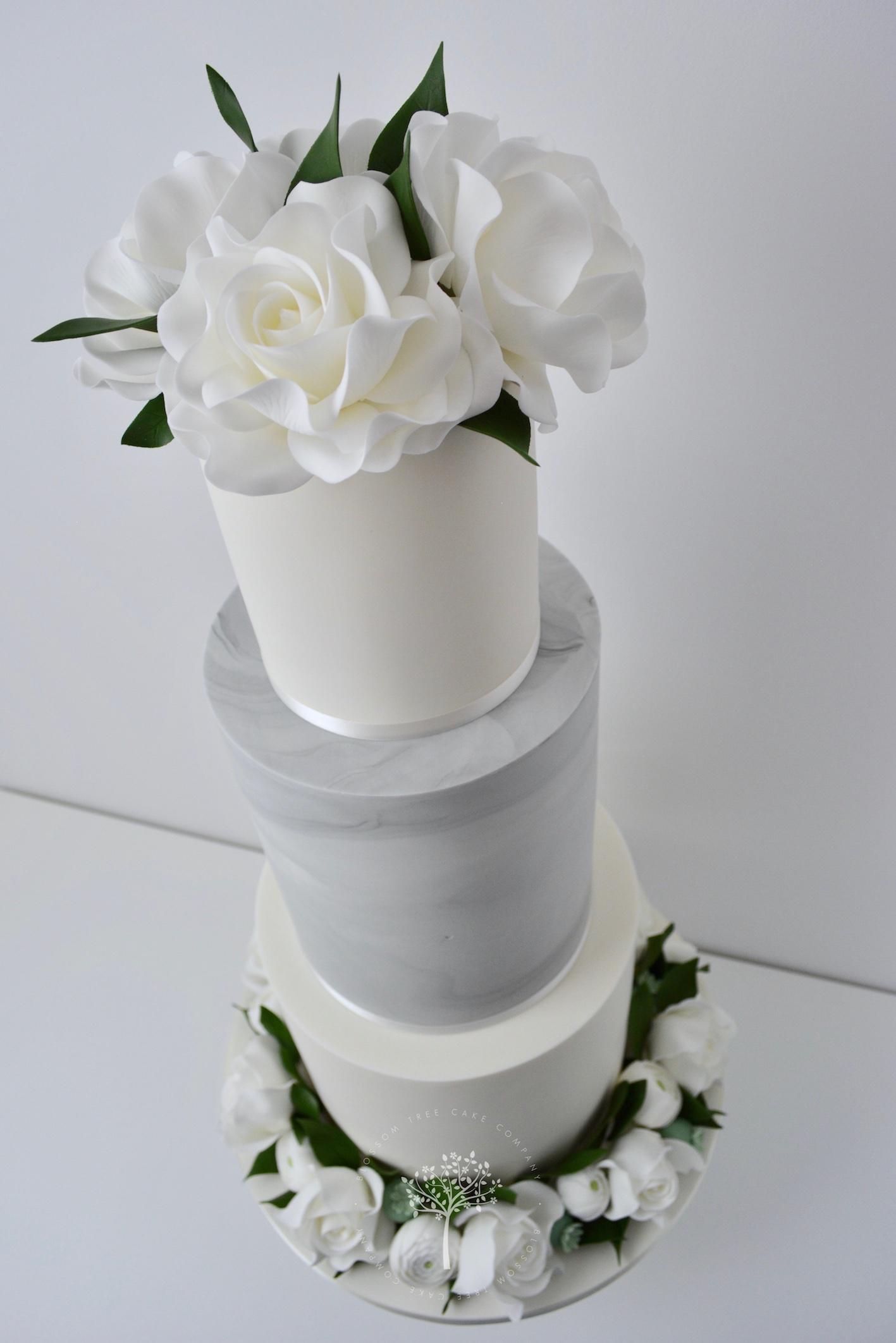 White Roses and Ranunculus wedding cake by Blossom Tree Cake Company Harrogate North Yorkshire - angle.jpg