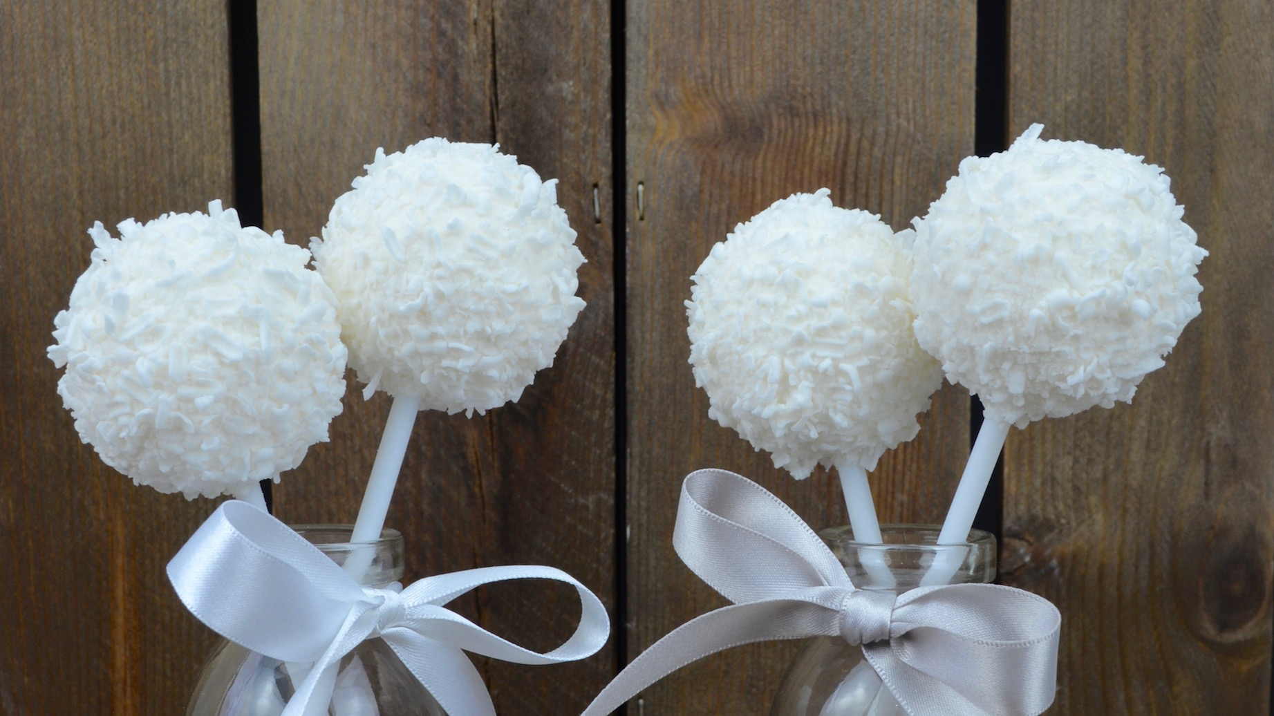 Cake Pops - Our cake pops come in a range of flavours and are hand made from the finest crumbed sponge cake mixed with light and fluffy buttercream. We can decorate in a range of designs to tie in with your wedding theme.