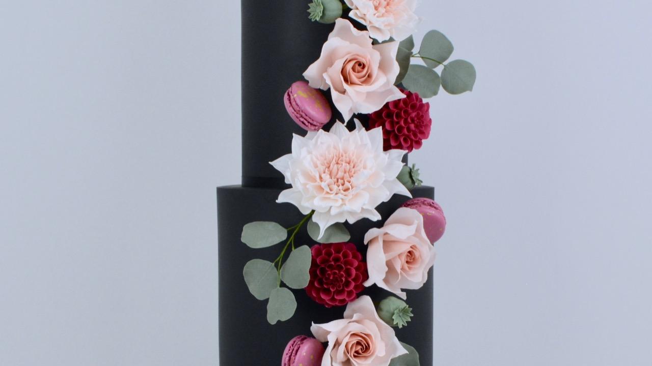 Dahlia & Black - Strikingly elegant dahlias, roses and blackberry macarons cascading against a dramatic backdrop for a spectacular wedding cake