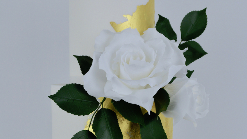 White Roses - Elegant simplicity and a contemporary timeless classic with the finest delicate white roses, rose leaf foliage and a splash of edible gold leaf