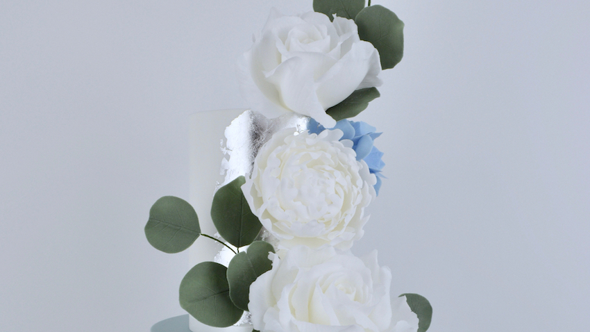 Peonies and Roses - A gorgeously elegant vertical cascade of dreamy white roses and peonies with splashes of blue hydrangea and eucalyptus