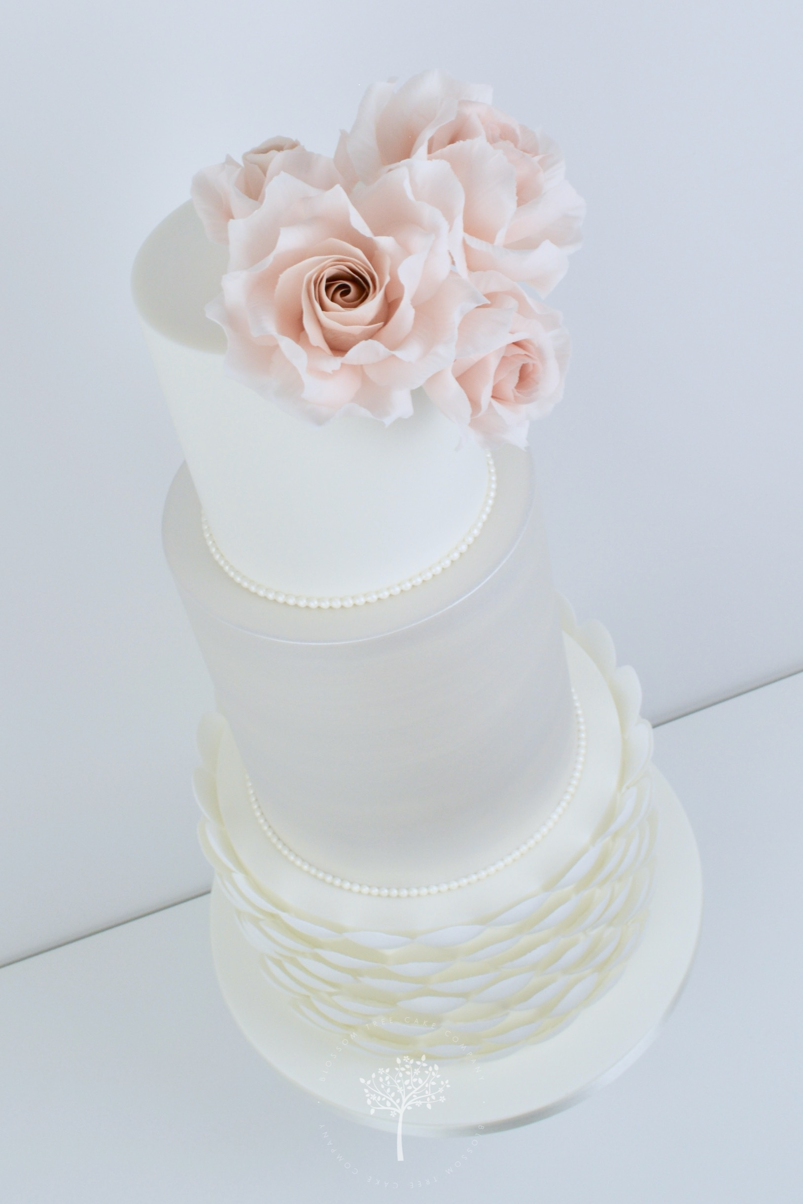 Pearlescent and Blush Petal Shells wedding cake by Blossom Tree Cake Company Harrogate North Yorkshire - angle.jpg