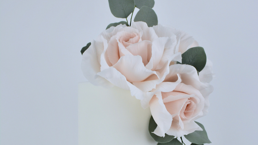 Blush Roses & Silver - Dusky nude pink roses, eucalyptus foliage, splashes of silver leaf and string of pearl icing for a contemporary and stylish design