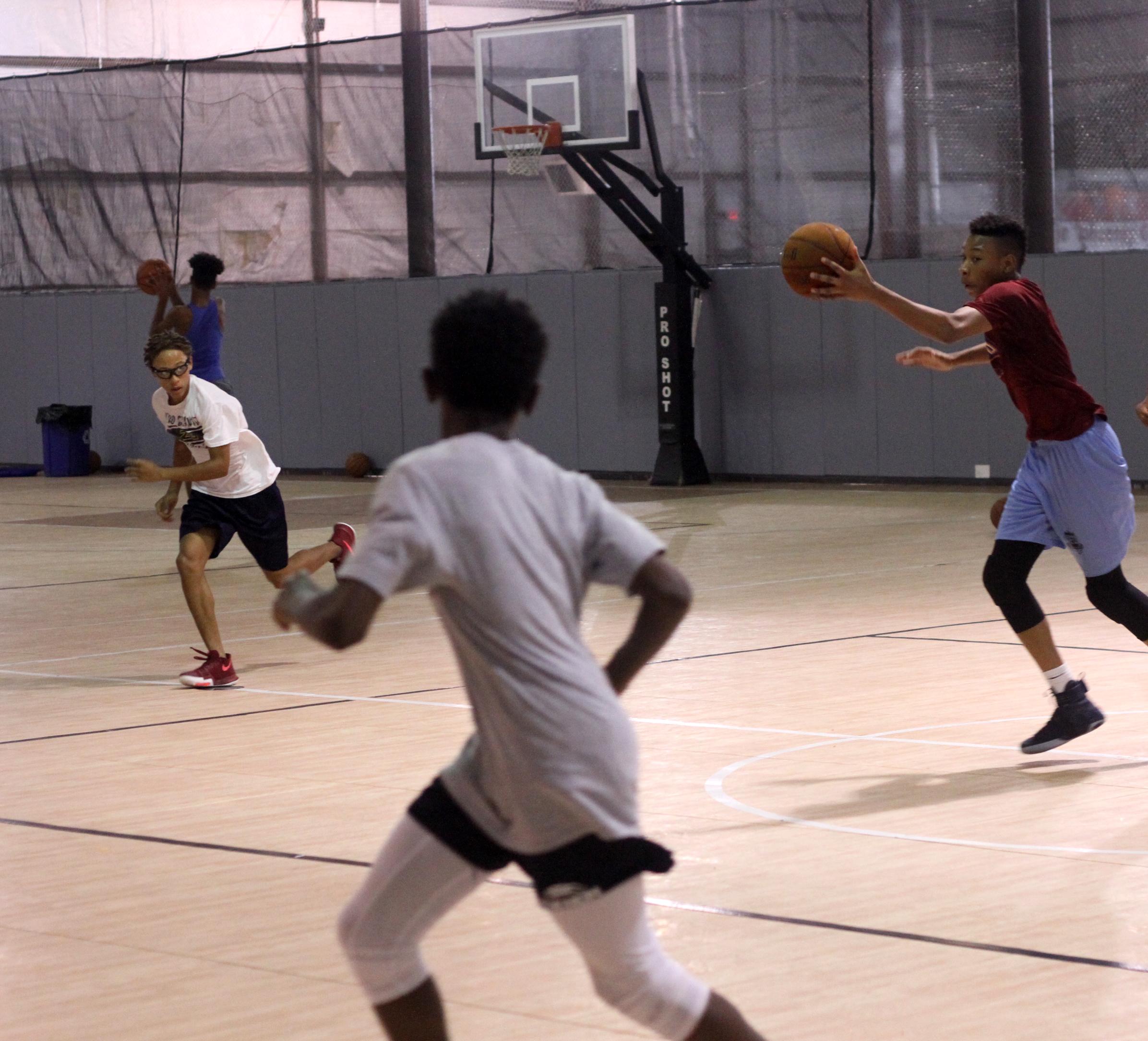 3 boys basketball.jpg