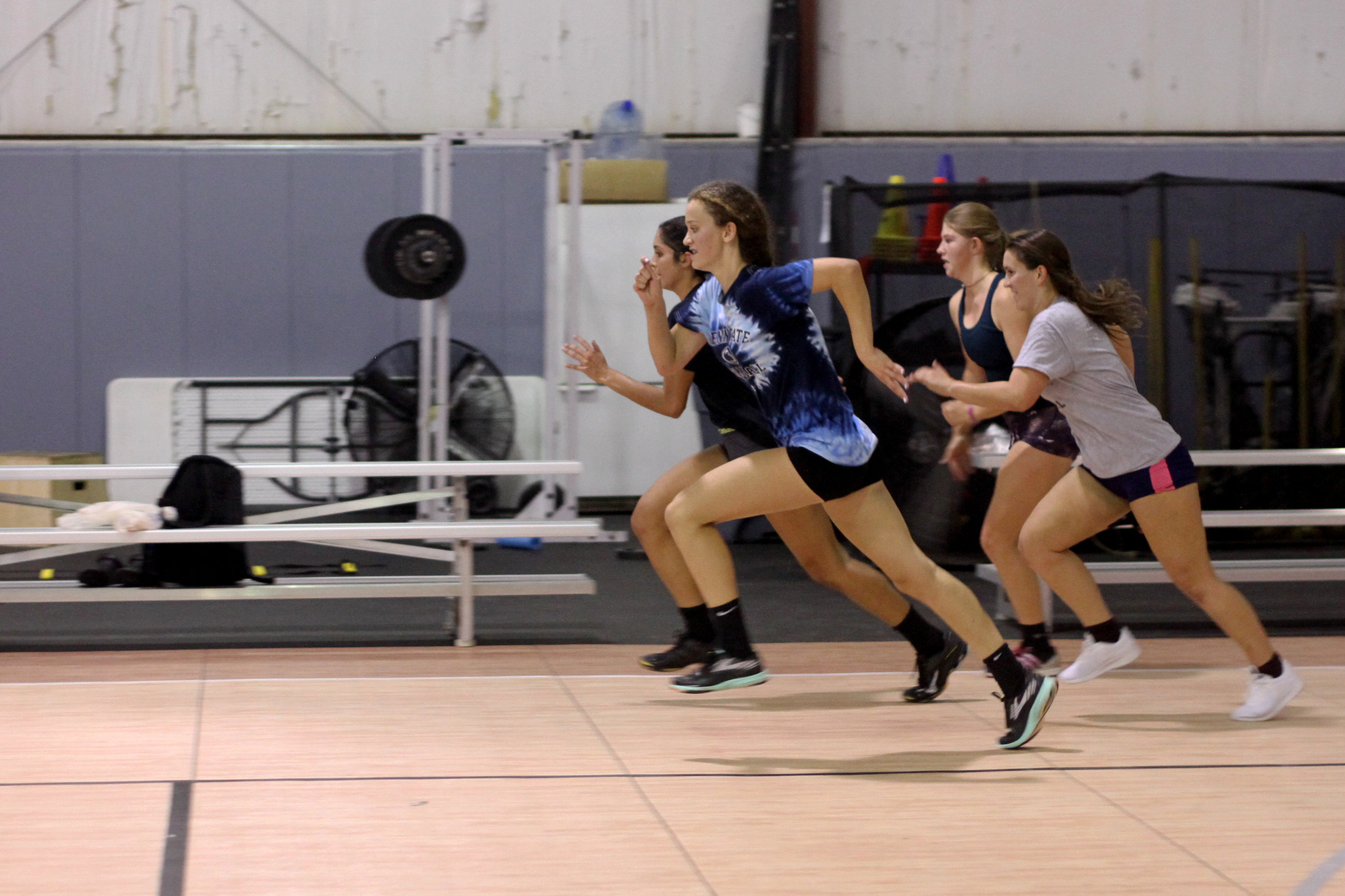 girls sprinting volleyball.jpg