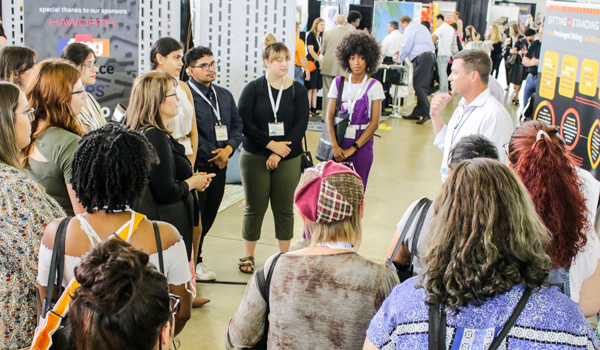 40 interior design students and new graduates were led on a tour of the trade show floor.