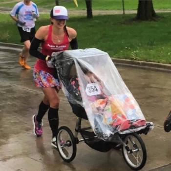 Pushing cousin Martilee during her first half marathon! 4/30/2016