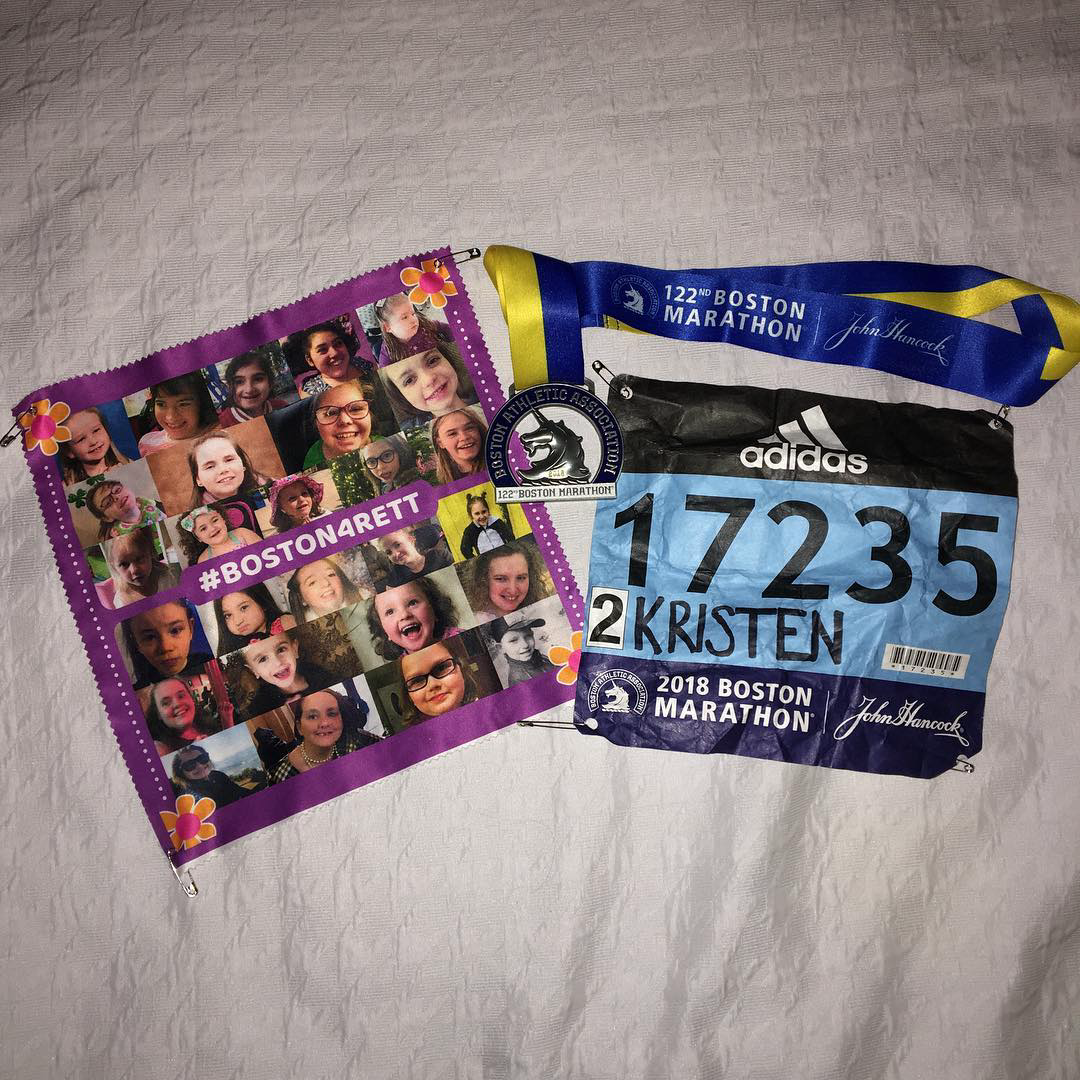 My bib, medal, and GP2C bib with the pictures of 27 beautiful little ones fighting against Rett Syndrome.