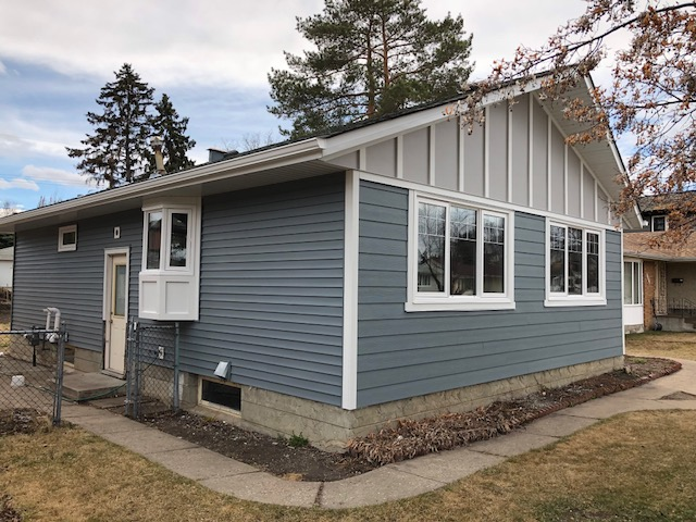 Siding: James Hardie Boothbay Blue &Pearl Gray and Mitten Vinyl Indigo Trim: Arctic White