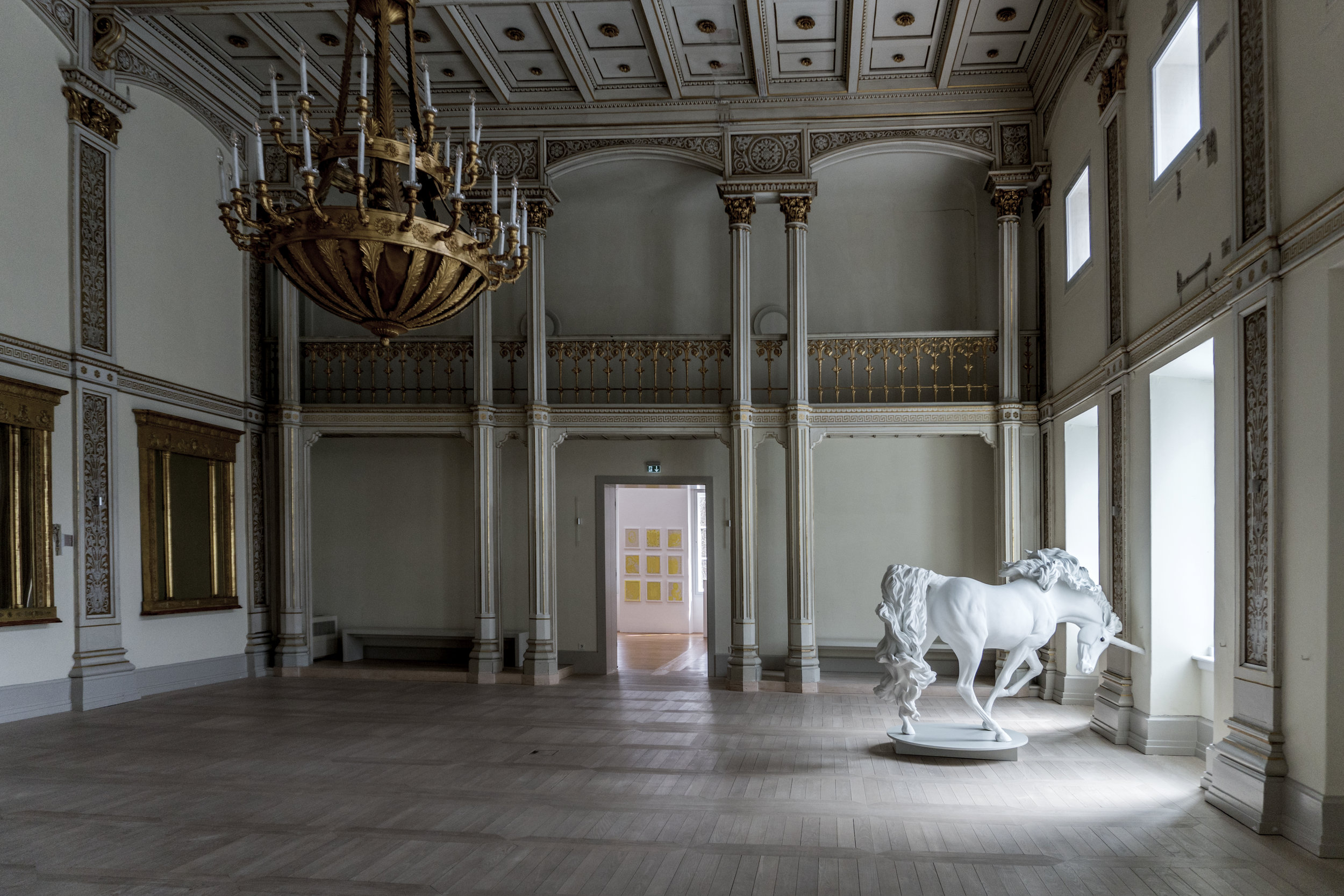 "The magnificent ballroom, all in creamy-white hues and gilt:  home to    Friedmann Flöther's   "" Unicorn ""  (2009-2010)"