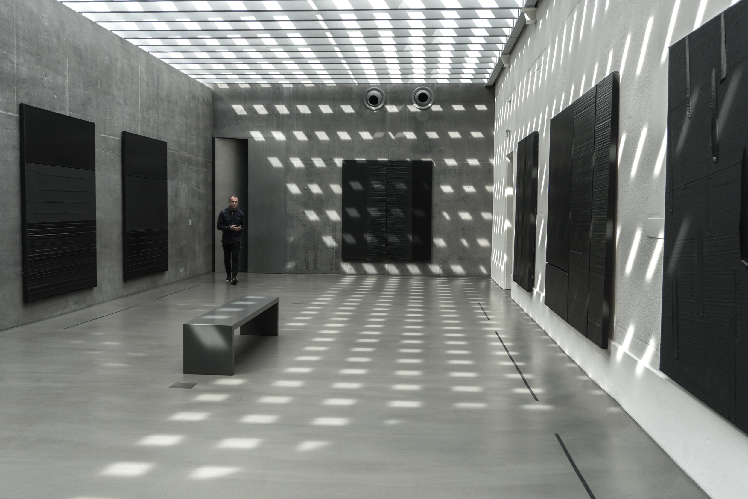 "The ""shrine"" of the  Soulages  collection, intertwined with light and concrete,  in the museum's new extension: a Chapel of Light dedicated to the painter's  Ode to Outrenoir ."
