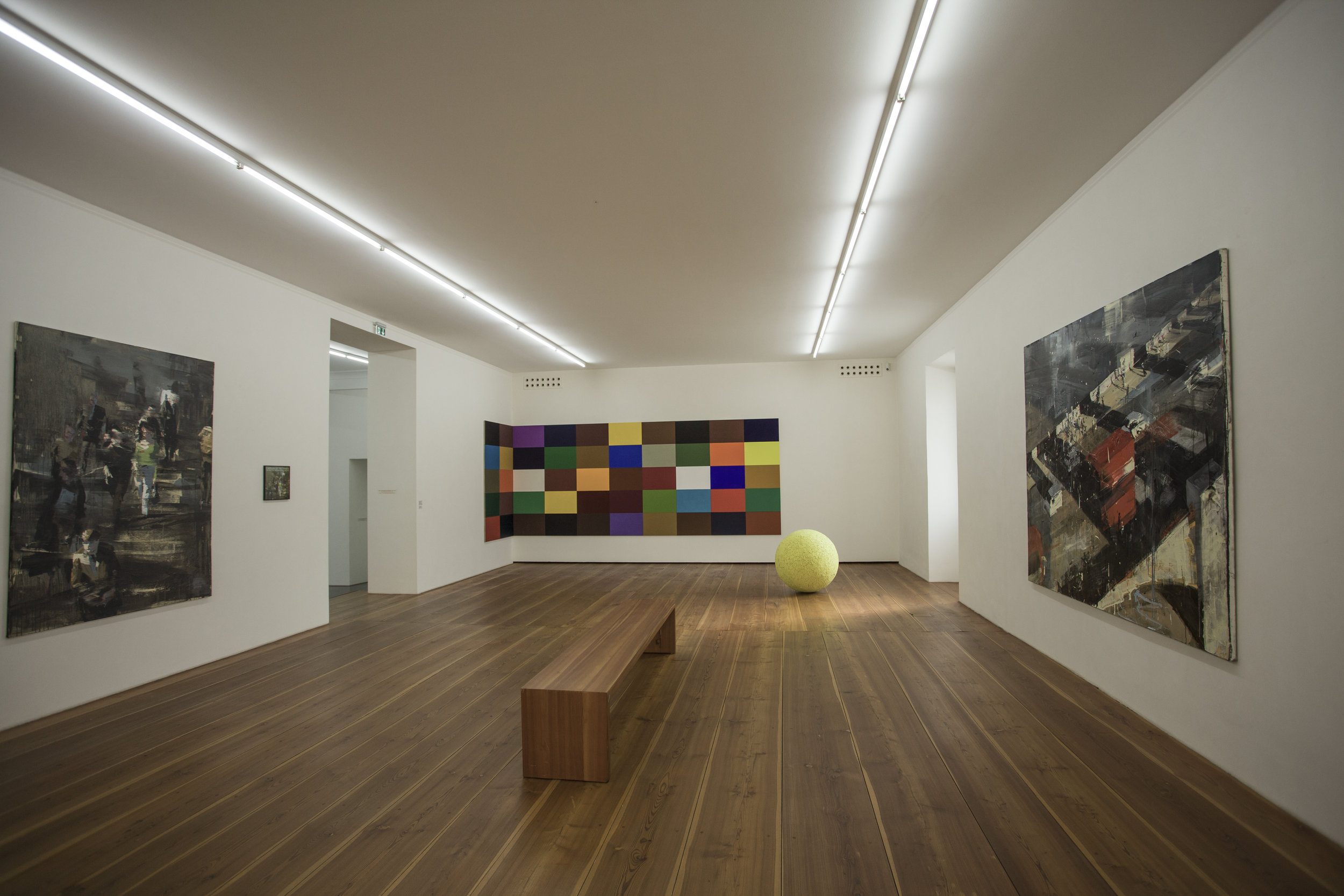 "(Left)     Matthew Radford , "" April City "" (1993-1994) -  (In the background)   Gerhard Langenfield , "" 50 Farbtafeln "" (2005) -  (On the floor)   Rainer Seliger , "" Pallone giallo "" (2010) -  (Right)   Matthew Radford , "" Red Bus II/London II "" (1995)"