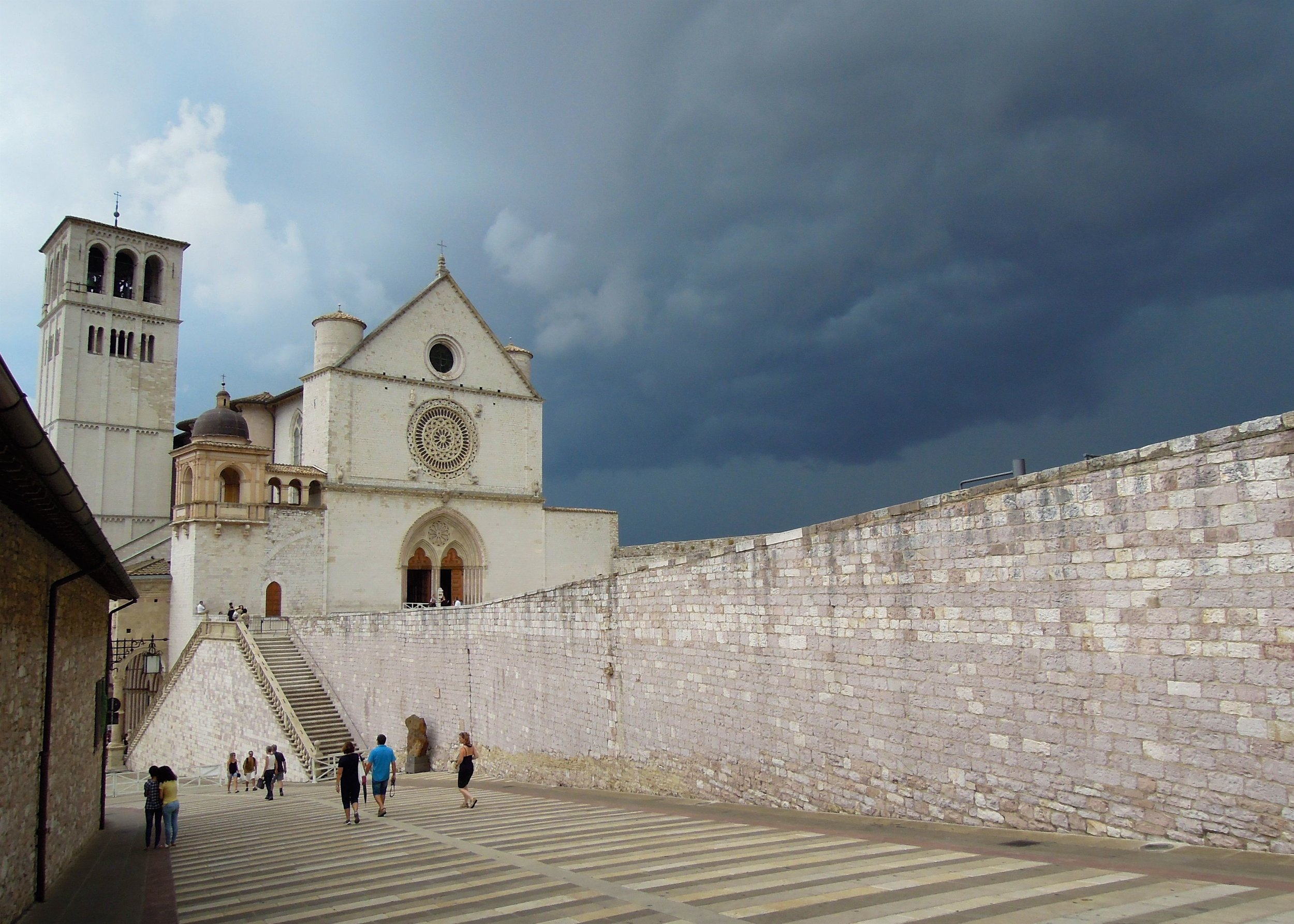 The skies about to break loose above Basilica of Saint Francis of Assisi. I highly recommend you also see the inside. Photograph: Alison Testroete