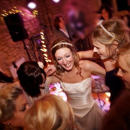 Sarah dancing with her bridesmaids.