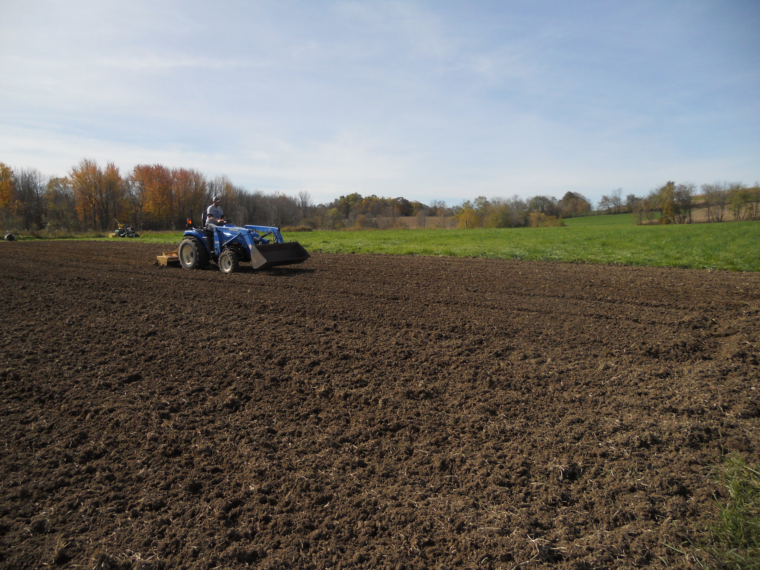Working the ground to keep it soft for planting.