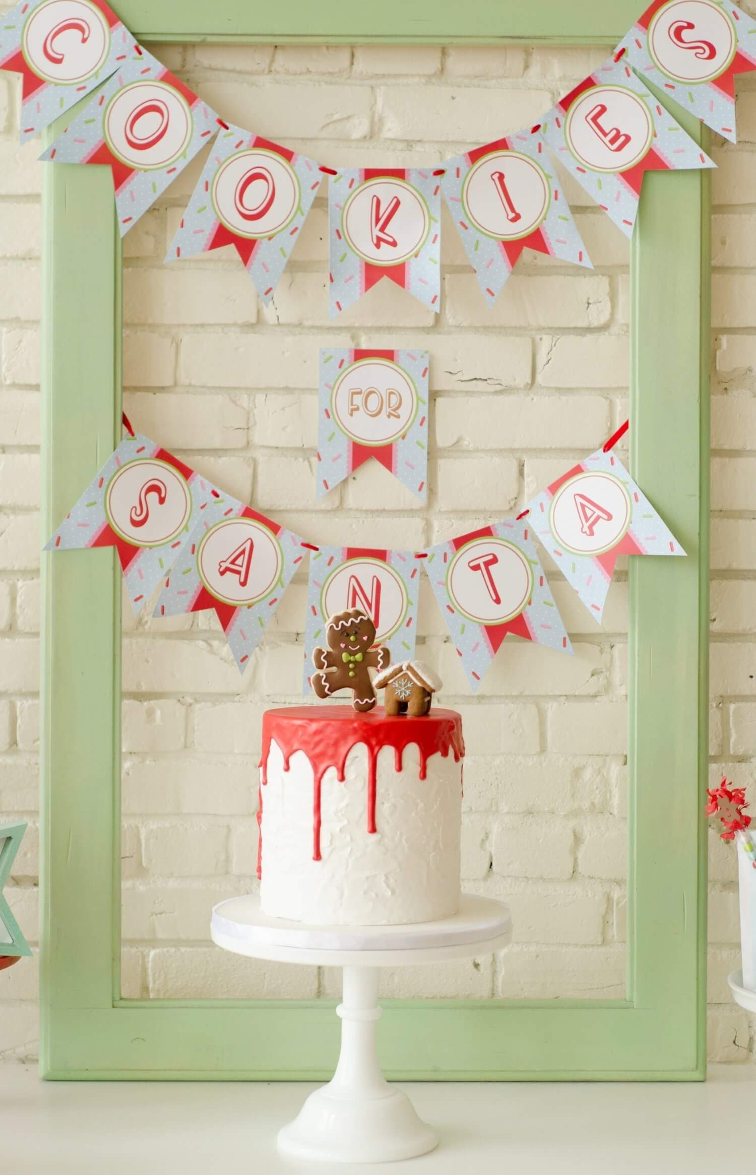 A holiday drip cake topped with a super cute gingerbread boy cookie and a mini gingerbread house. Loving the Cookies for Santa party banner printable as a backdrop. See more from this Cookies for Santa party on www.minteventdesign.com - styled by Austin, Texas based party planner Mint Event Design. #holidayparty #holidaypartyideas #christmaspartyideas #christmascake #holidaydesserts #partybanner