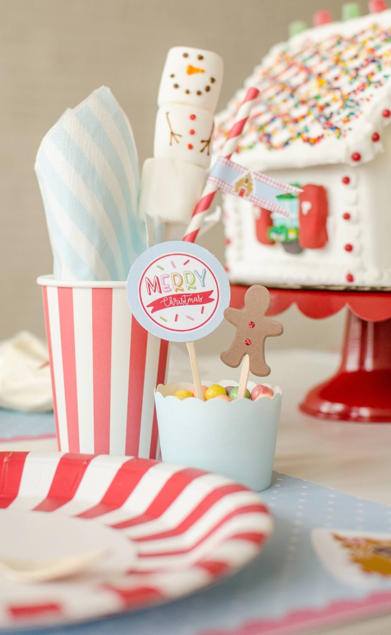 Merry Christmas and Gingerbread boy cupcake toppers as a party decoration for a holiday party. See more from this Cookies for Santa party on www.minteventdesign.com - styled by Austin, Texas based party planner Mint Event Design. #holidayparty #holidaypartyideas #christmaspartyideas #cupcaketoppers