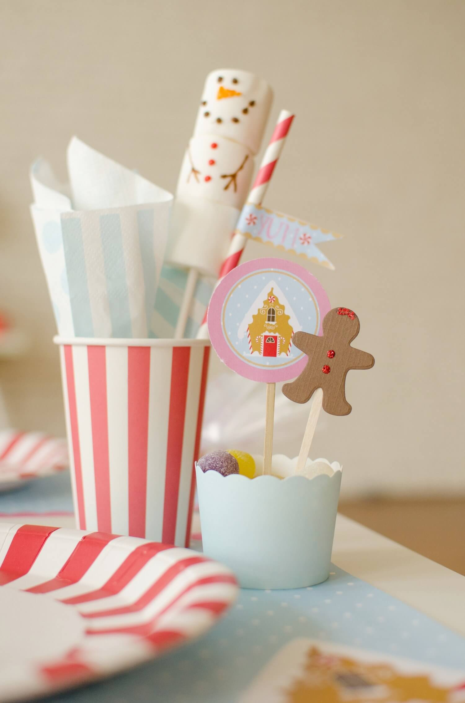 Dress up your holiday party with printable cupcake toppers and candy cane partyware. See more from this Cookies for Santa party on www.minteventdesign.com - styled by Austin, Texas based party planner Mint Event Design. #holidayparty #holidaypartyideas #christmaspartyideas #partysupplies #partyprintables #cupcaketoppers