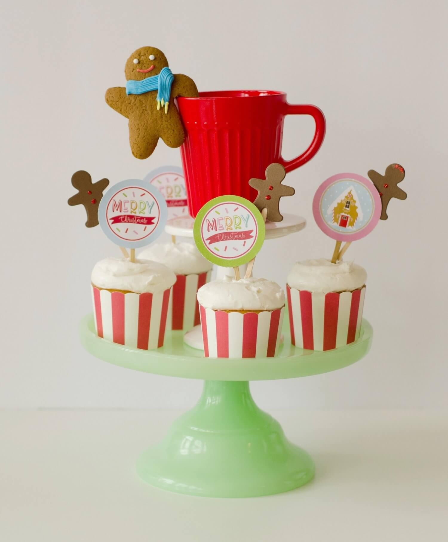 Dress up your holiday party with printable cupcake toppers and candy cane striped cupcake wrappers. See more from this Cookies for Santa party on www.minteventdesign.com - styled by Austin, Texas based party planner Mint Event Design. #holidayparty #holidaypartyideas #christmaspartyideas #partysupplies #partyprintables #cupcaketoppers