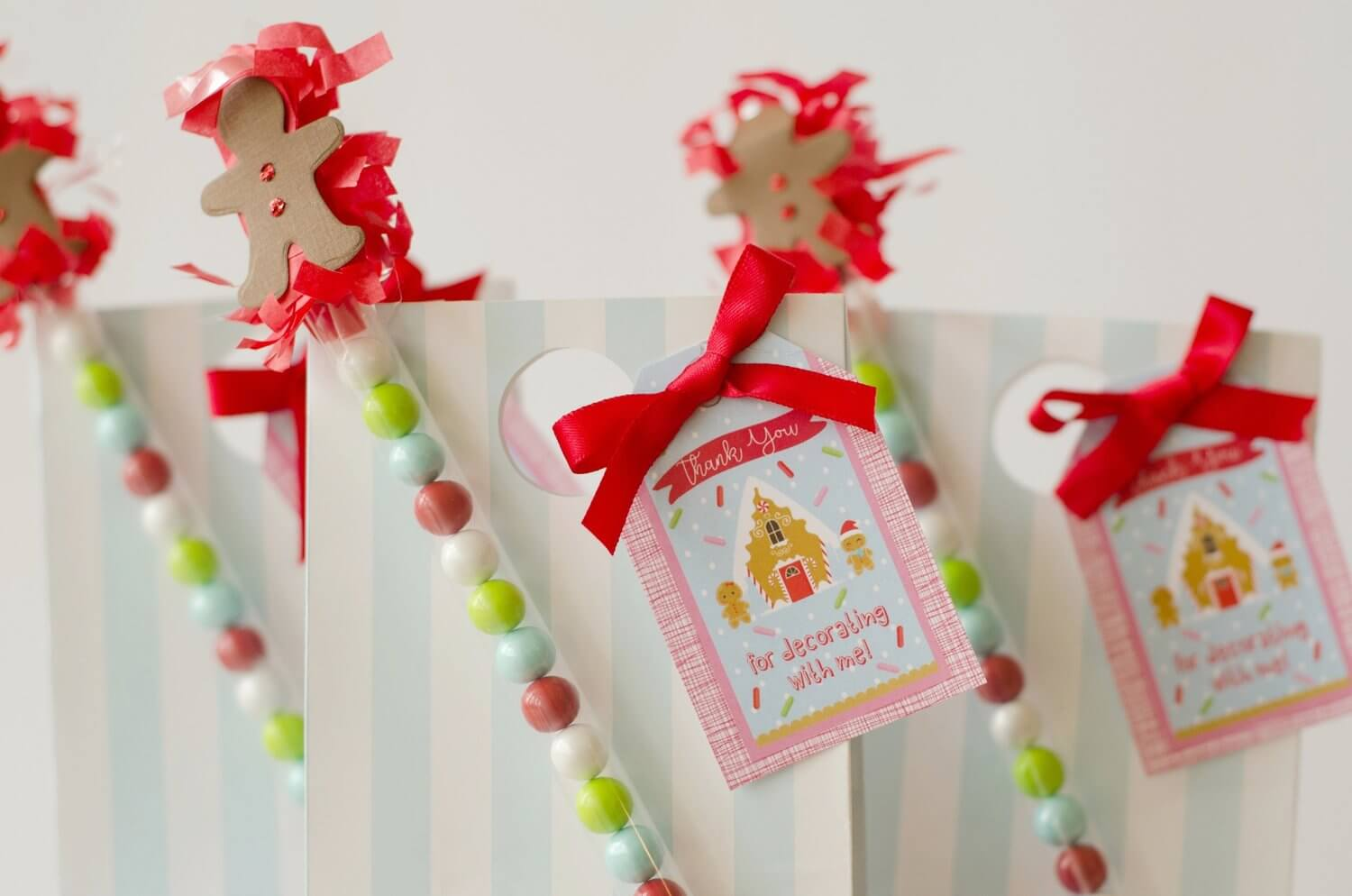 These cute candy wands are the perfect detail for the Christmas cookie decorating party favor bags. See more from this Cookies for Santa party on www.minteventdesign.com - styled by Austin, Texas based party planner Mint Event Design. #holidayparty #holidaypartyideas #christmaspartyideas #partyfavors #favorbags
