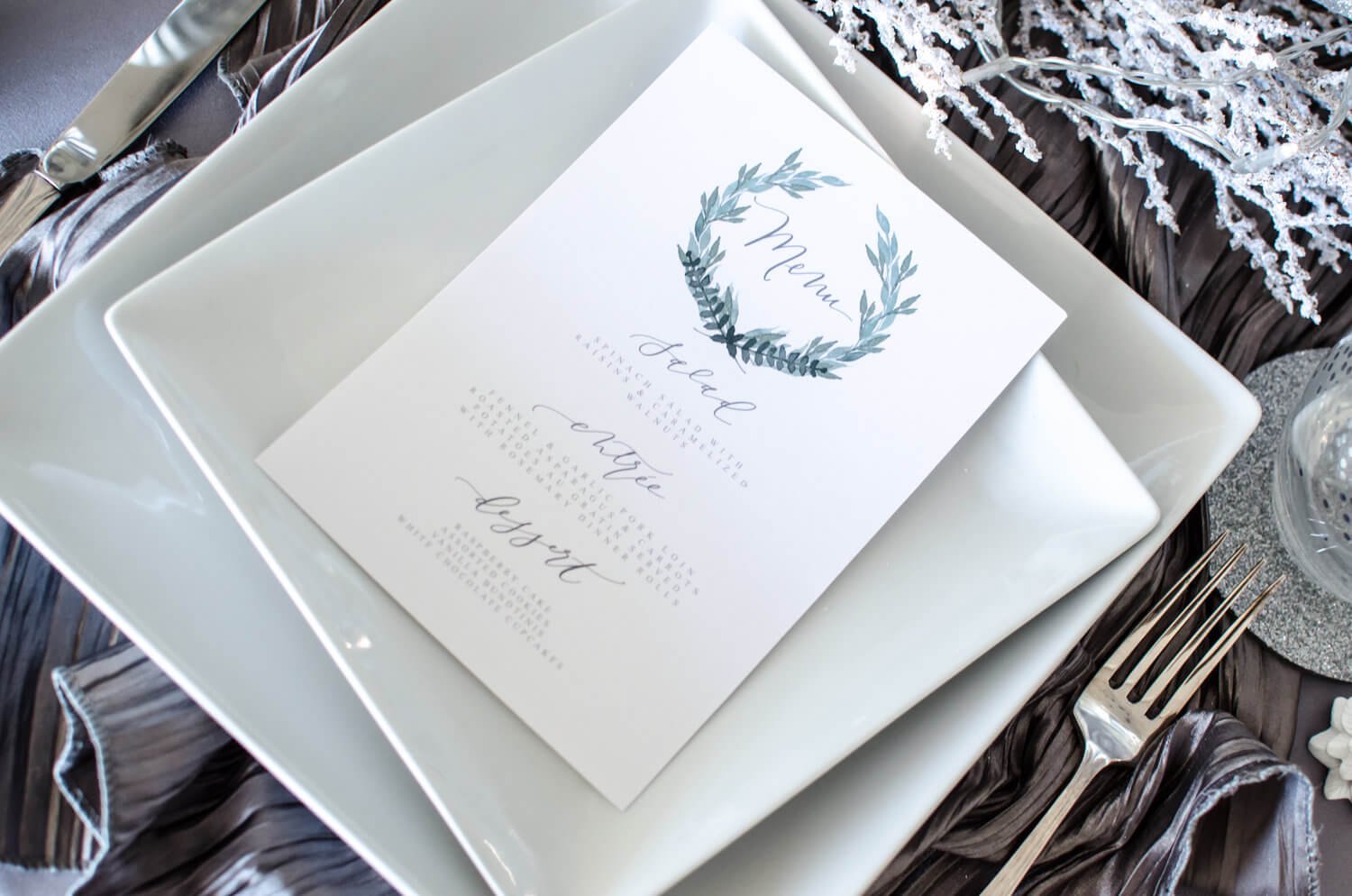 Pretty menu cards with calligraphy for a winter party. See more ideas from this Winter Wonderland themed Bridal Shower Inspiration created by Mint Event Design www.minteventdesign.com #winterweddingideas #weddingwedding #bridalshowerideas #winterwonderland #calligraphy #menudesign
