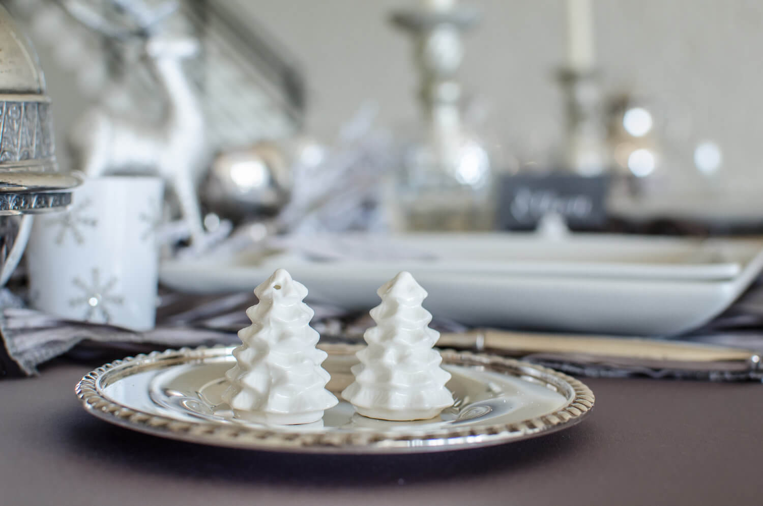 The cutest white tree salt and pepper shakers for a winter themed party. See more ideas from this Winter Wonderland themed Bridal Shower Inspiration created by Mint Event Design www.minteventdesign.com #winterweddingideas #weddingwedding #bridalshowerideas #winterwonderland