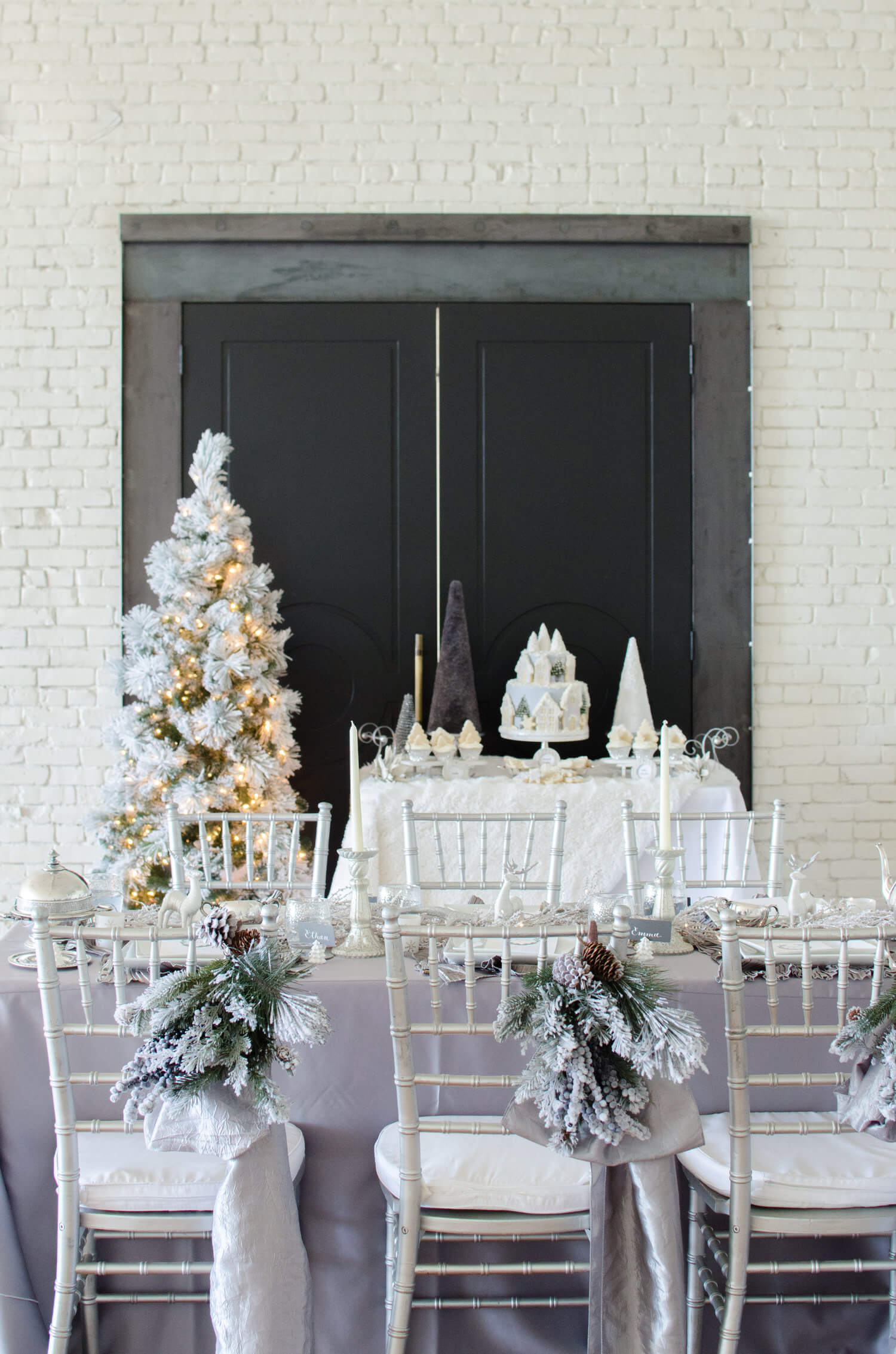 Winter Party Chivari Chairs decorated with flocked pine boughs, pine cones and a shimmery grey sash. See more ideas from this Winter Wonderland themed Bridal Shower Inspiration created by Mint Event Design www.minteventdesign.com #winterweddingideas #weddingwedding #bridalshowerideas #winterwonderland #chairdecor #chairdecorations