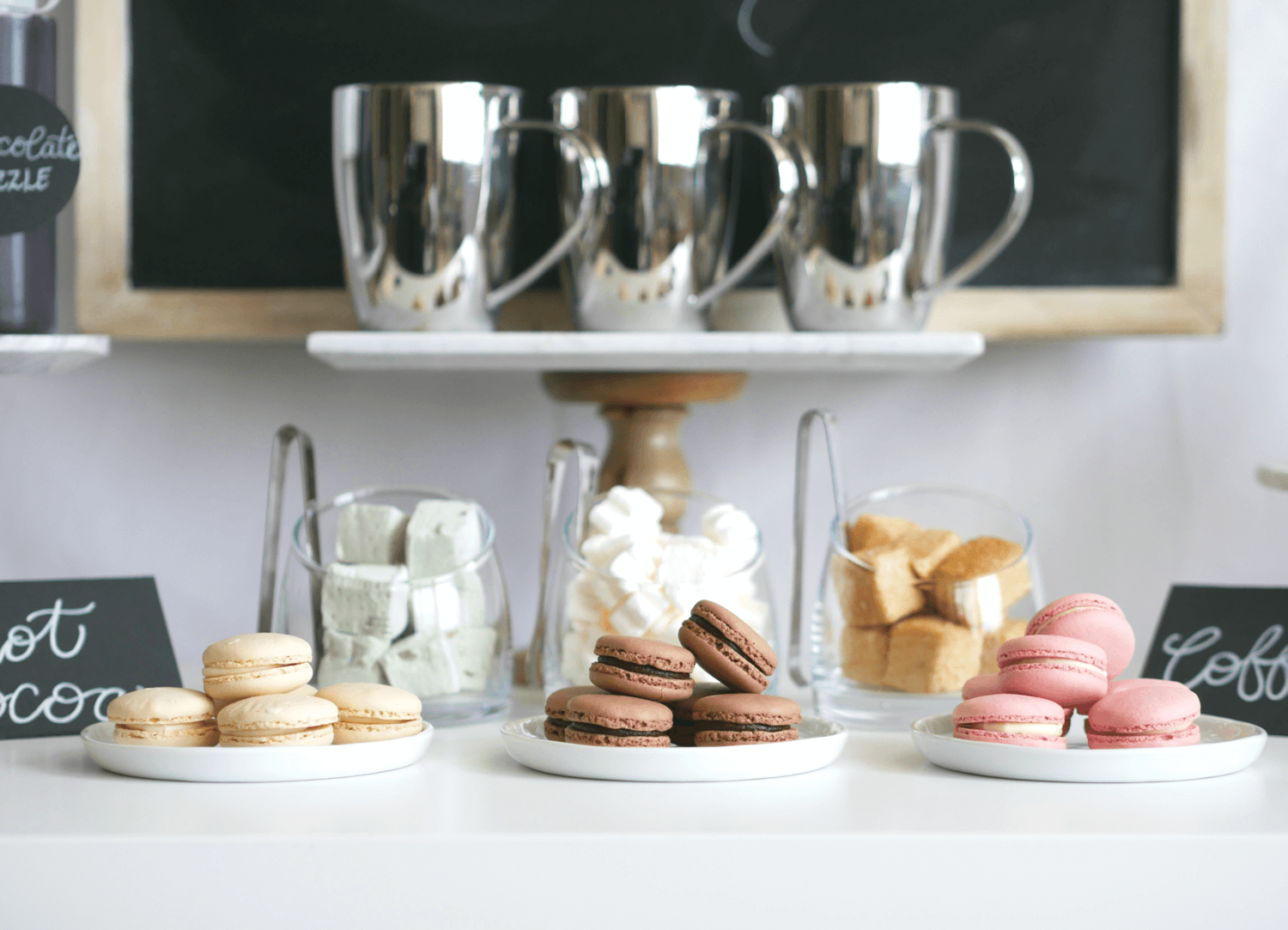 Sweet Vanilla, Chocolate and Raspberry Macarons for a Hot Cocoa and Coffee Bar Station. Click for details on this DIY Hot Cocoa and Coffee Bar. Styled by party stylist Mint Event Design. #partyideas #partyinspiration #hotchocolate #hotcocoa #coffeebar #coffeestation #winterparty #winterwedding #macarons