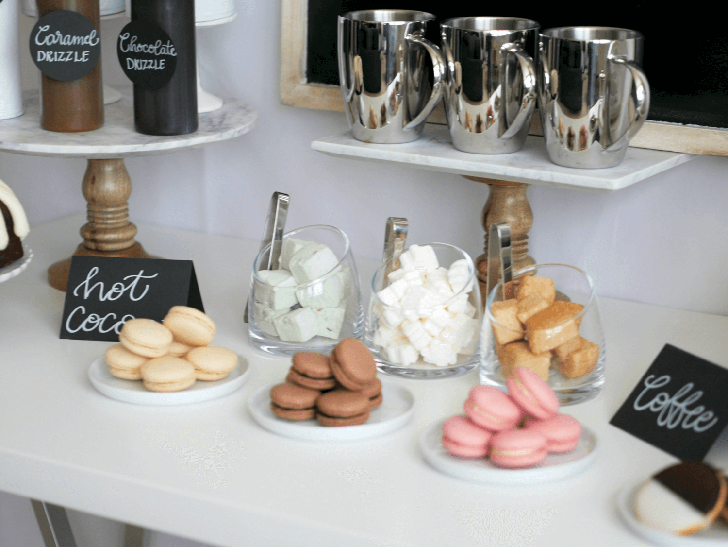 Yummy Macarons in Vanilla Chocolate and Raspberry are showcased in this DIY Hot Cocoa and Coffee Bar. Styled by party stylist Mint Event Design. #partyideas #partyinspiration #hotchocolate #hotcocoa #coffeebar #coffeestation #winterparty #winterwedding #macarons