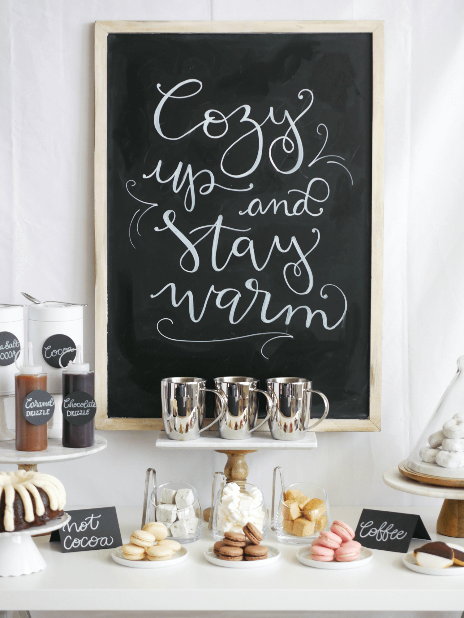 Cozy up and stay warm with this beautiful DIY Chalkboard Sign. Add flair to your Hot Cocoa and Coffee Station with this handmade chalkboard sign. Styled by party stylist Mint Event Design. #partyideas #partyinspiration #hotchocolate #hotcocoa #coffeebar #coffeestation #winterparty #winterwedding #chalkboardsign