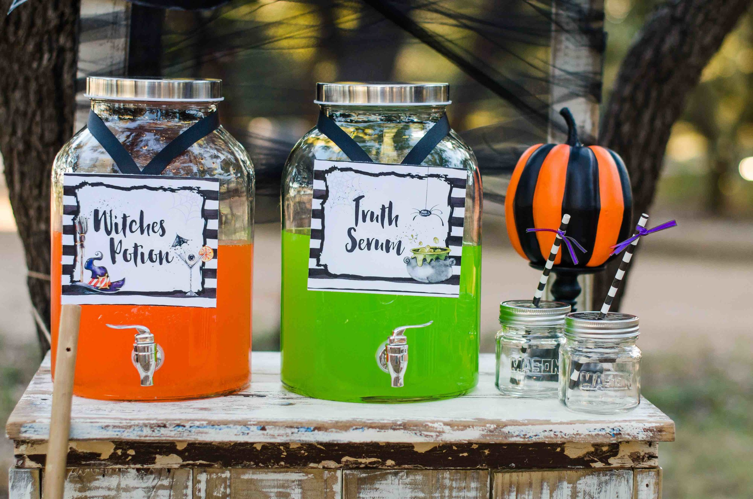 Have fun with your Halloween Party Drink Station - serve brightly colored drinks and have mason jars ready for filling with the Halloween potions. Click to see all the Halloween Party Ideas that you can re-create for your very own Halloween Kids Party. Styled by party stylist Mint Event Design. #halloween #partyideas #partyinspiration #halloweendrinks #drinkstation