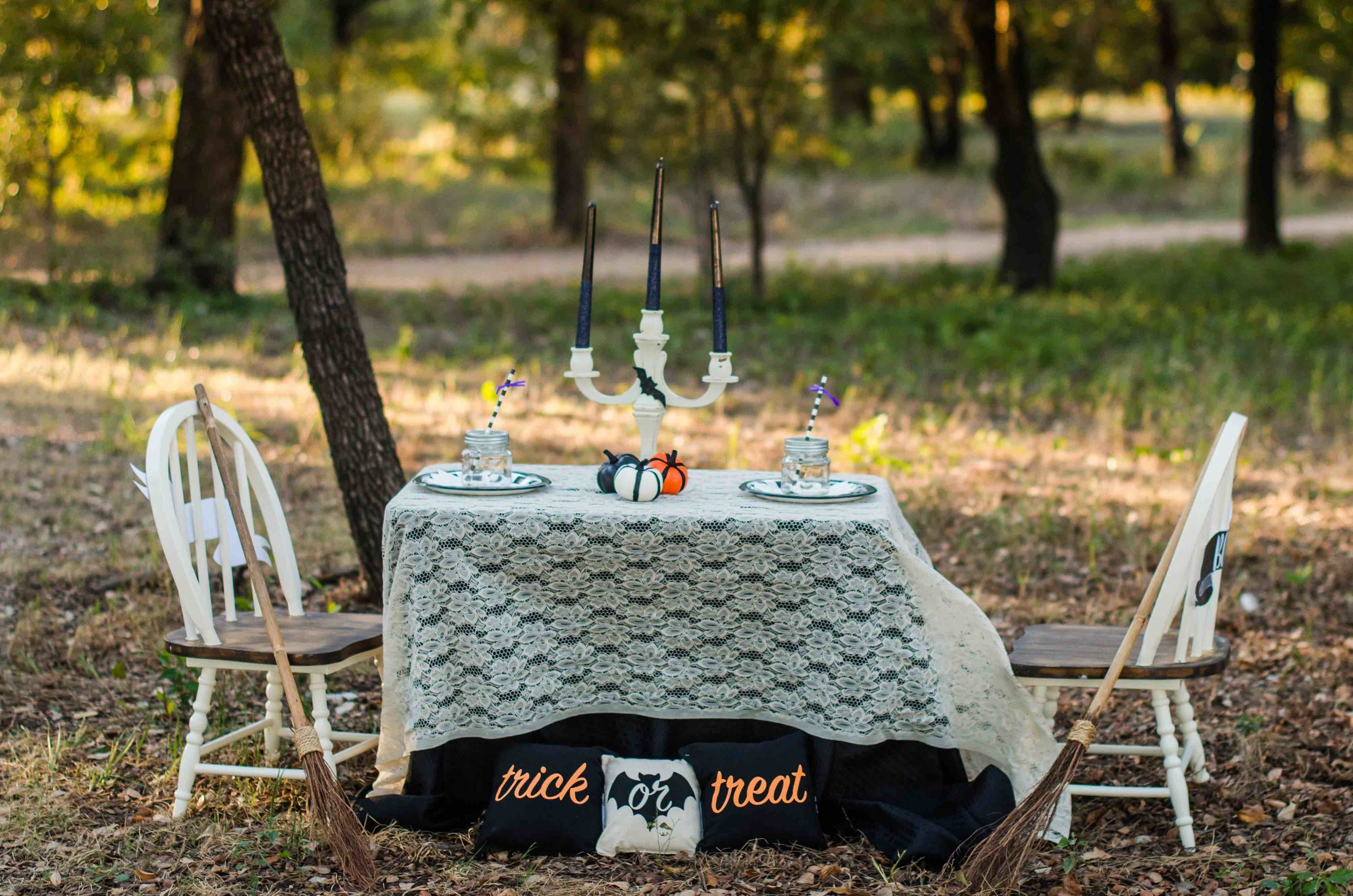 Trick or Treat - it's a cute Halloween Party Tablescape for a Kids Halloween Party - layer a lace tablescloth over a black linen and it's the perfect choice for a Hallowen Celebration. Click to see all the Halloween Party Ideas that you can re-create for your very own Halloween Kids Party. Styled by party stylist Mint Event Design. #halloween #partyideas #partyinspiration #partydecor #tablescape #halloweendecor #halloweendecorations