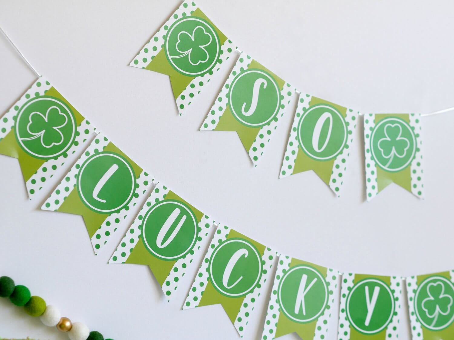 Click to download this FREE party banner for Saint Patricks Day that reads So Lucky with shamrocks and polka dots. As seen on Mint Event Design www.minteventdesign.com #partyideas #partydecorations #freeprintables #saintpatricksday #stpatricksday #shamrock #partybanner