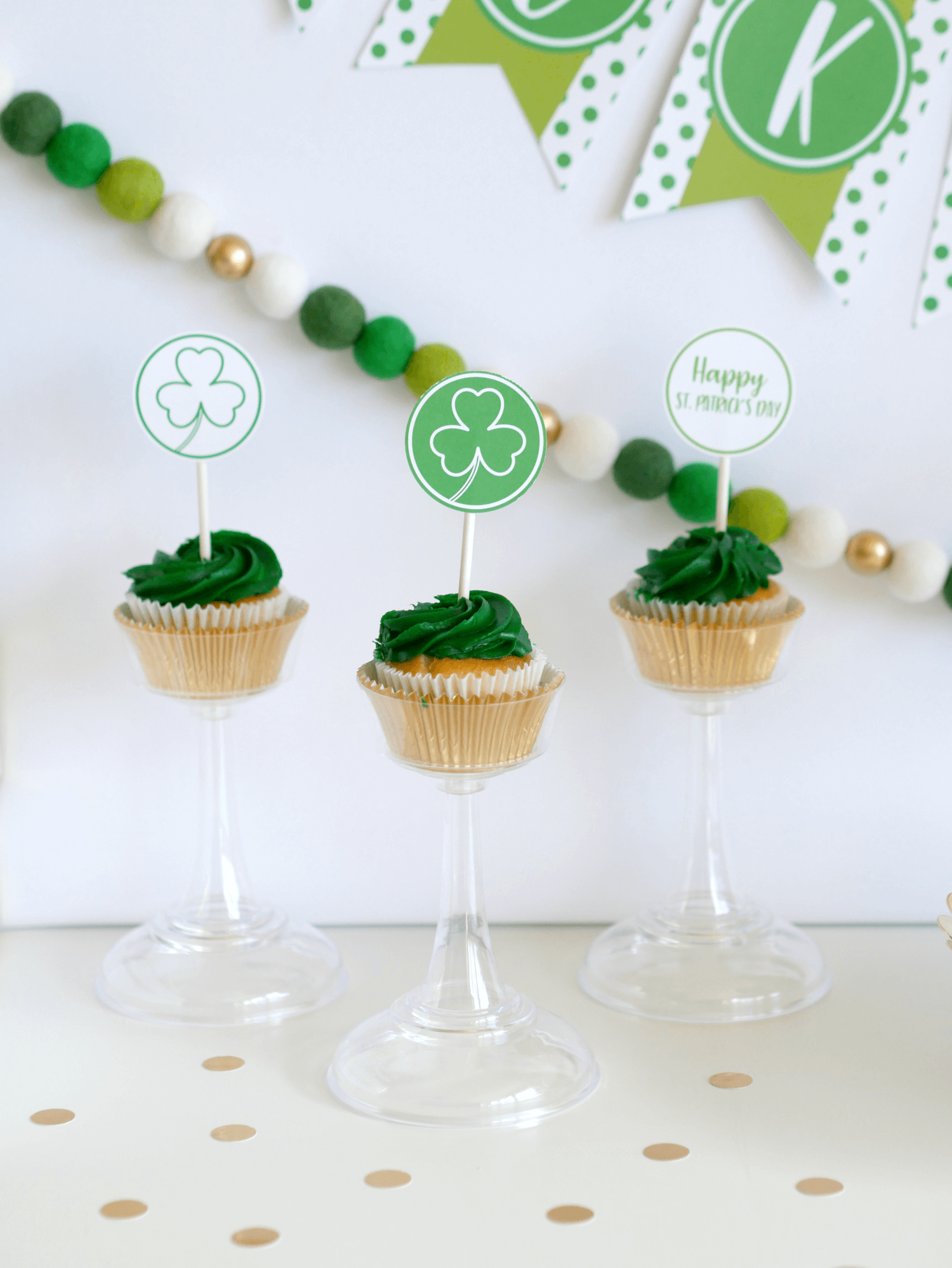Elevate your cupcakes on these charming cupcake stands and make a statement at your next party. PS: These cupcake toppers are available as a free printable at Mint Event Design www.minteventdesign.com #partyideas #partydecorations #freeprintables #saintpatricksday #stpatricksday #shamrock #cupcakes