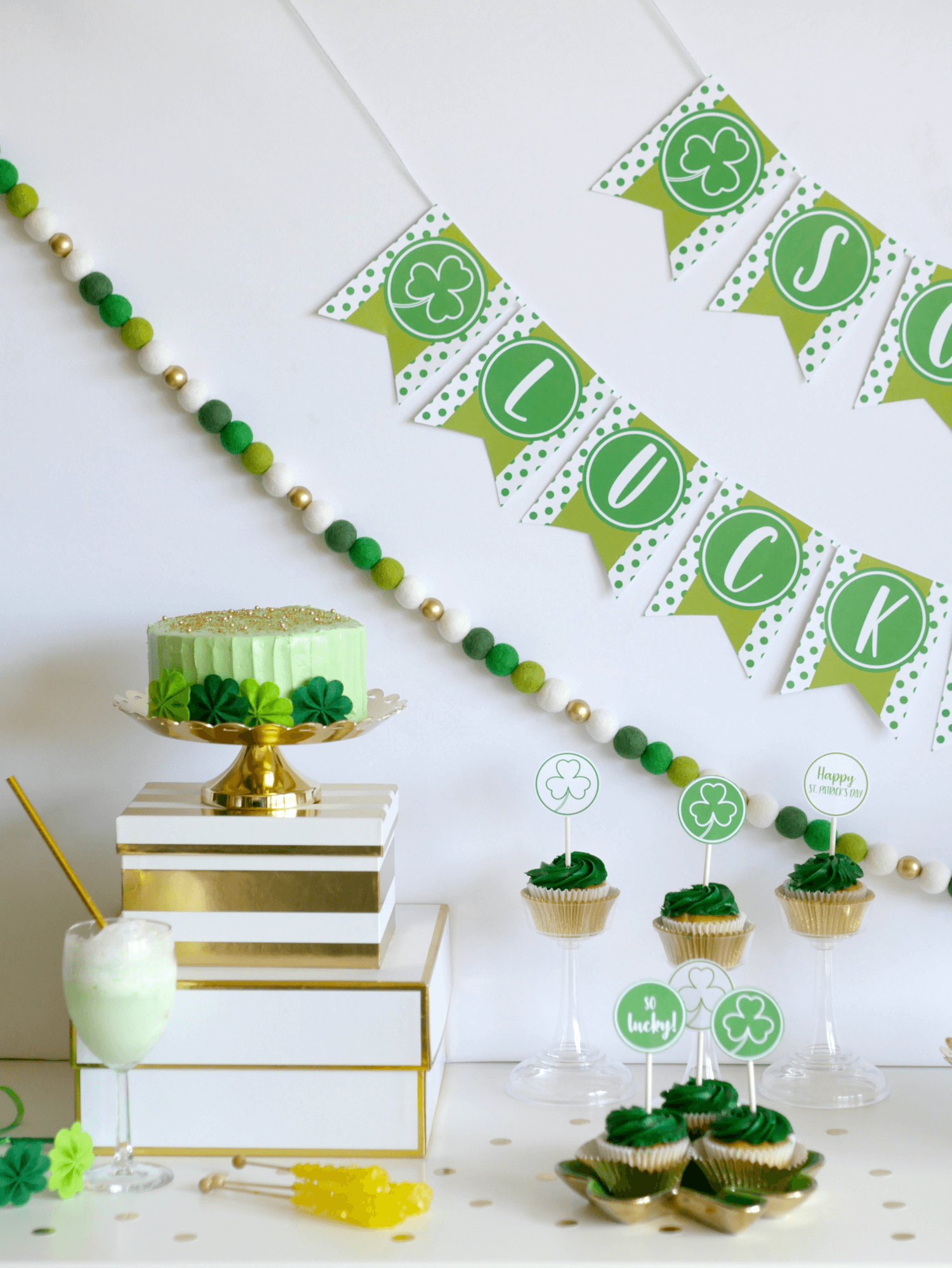 Saint Patricks Day Party Color Palette: shades of green including mint with white, gold and a pop of yellow with the rock candy. A sprinkling of gold circle confetti adds a fun decoration to the dessert table. See more from this St Patricks Day Party on Mint Event Design www.minteventdesign.com #partyideas #partydecorations #saintpatricksday #stpatricksday #desserttable