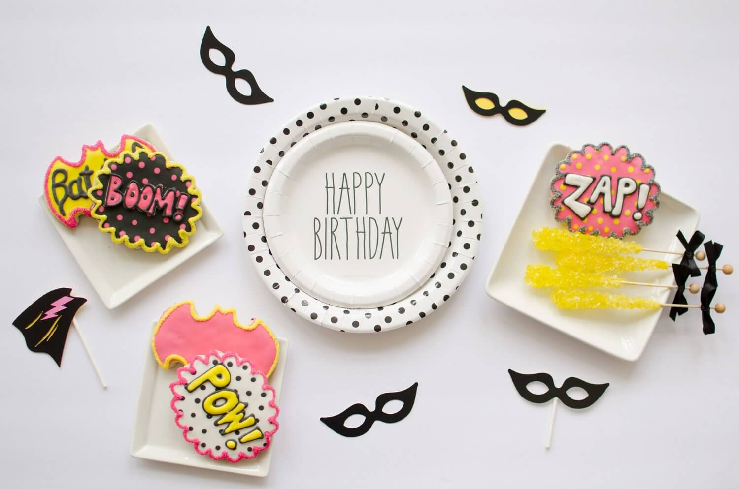 Can't forget about the cookies at a super hero birthday party - here the cookies are shaped like bats and word bubbles that read Boom!, Pow! and Zap! - see more kids party ideas on Mint Event Design www.minteventdesign.com