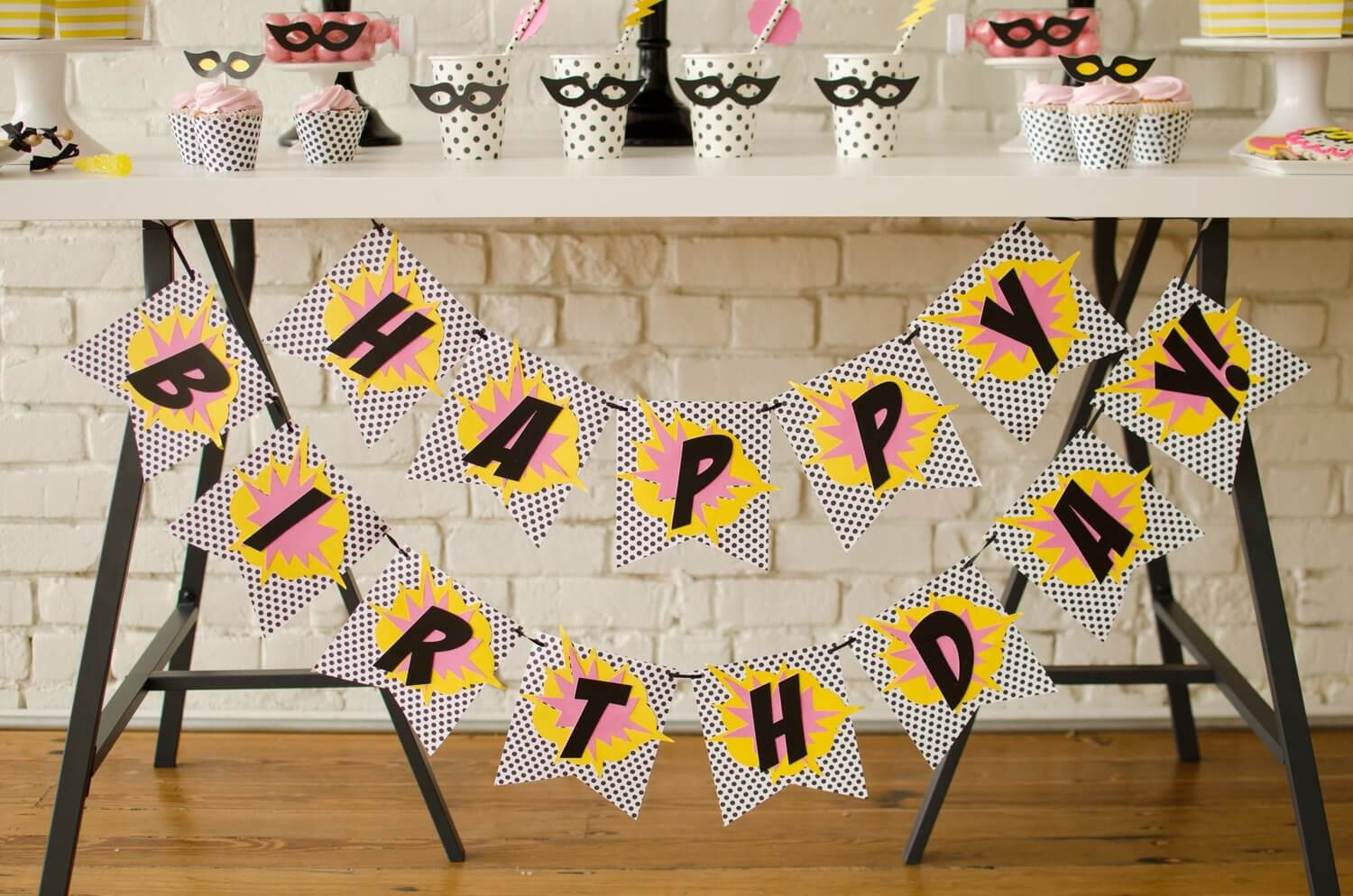 Dress up the front of your dessert table with a colorful Happy Birthday banner that matches the party colors - see more kids party ideas on Mint Event Design www.minteventdesign.com