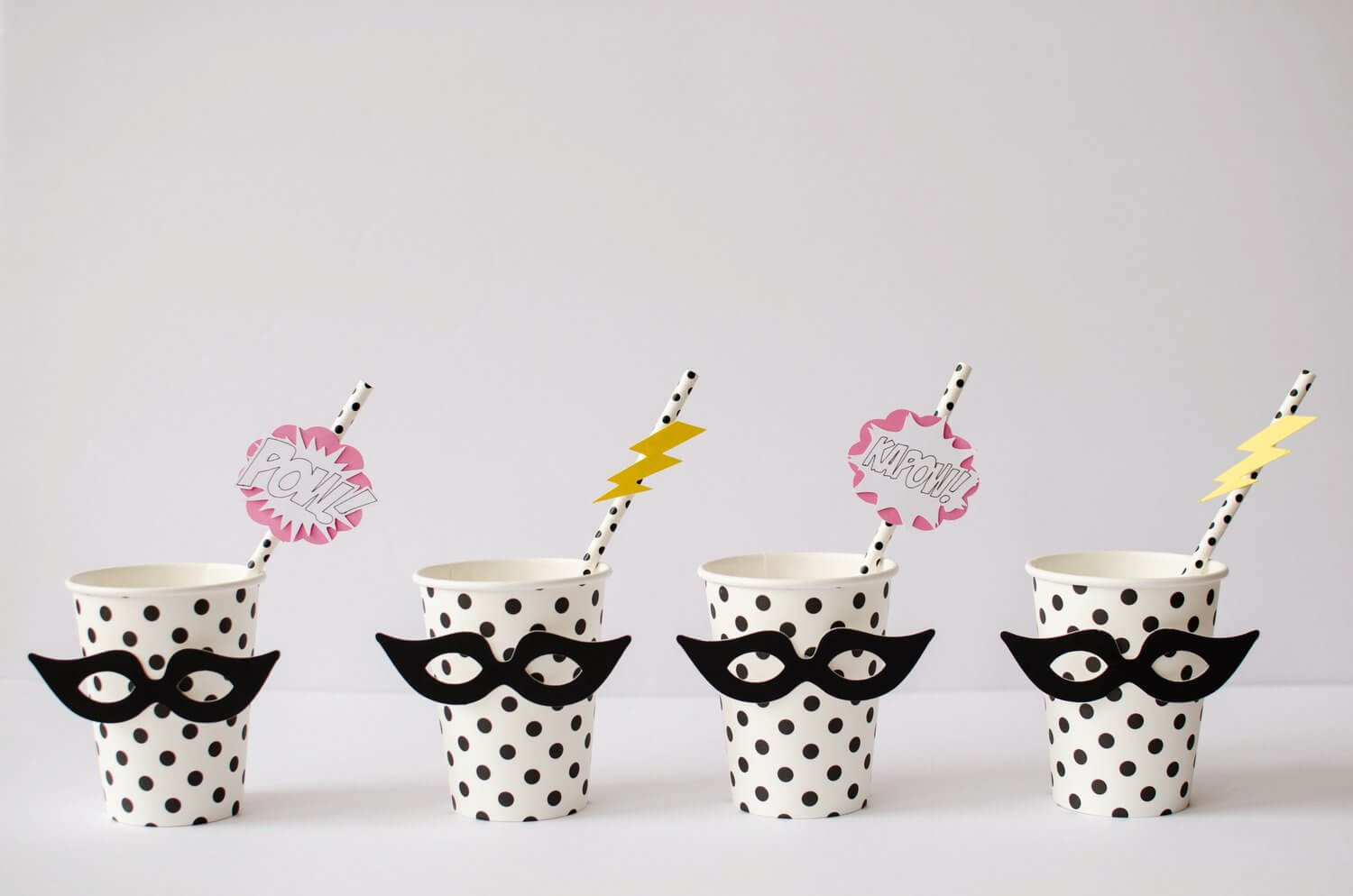 Don't forget to dress up your party cups and straws with coordinating Super Hero Masks and superhero sayings including POW! - see more kids party ideas on Mint Event Design www.minteventdesign.com