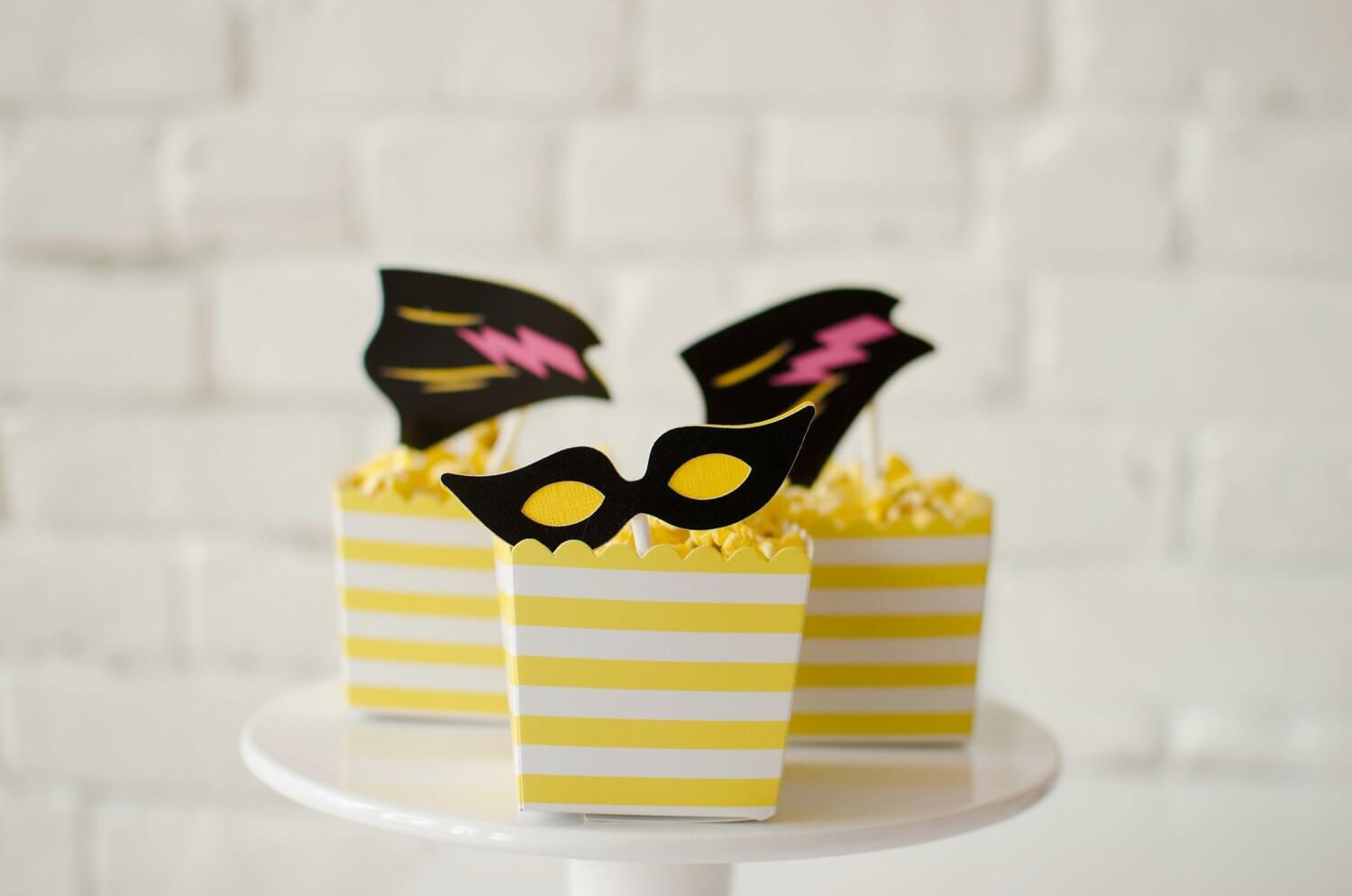 Don't forget that cupcake toppers can also be used on snacks - here the toppers dress up boxes of popcorn - see more kids party ideas on Mint Event Design www.minteventdesign.com